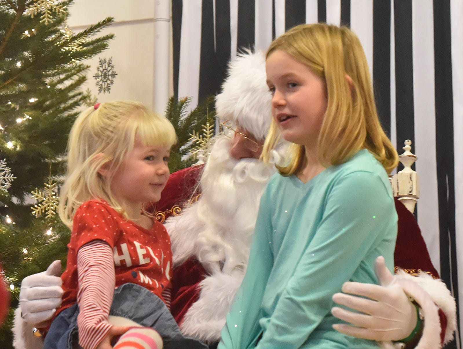 Emma and Natalie Nelson of Madison talk to Santa during Christmas in the Village in Ephraim on Saturday, Dec. 1, 2018. Tina M. Gohr/USA TODAY NETWORK-Wisconsin