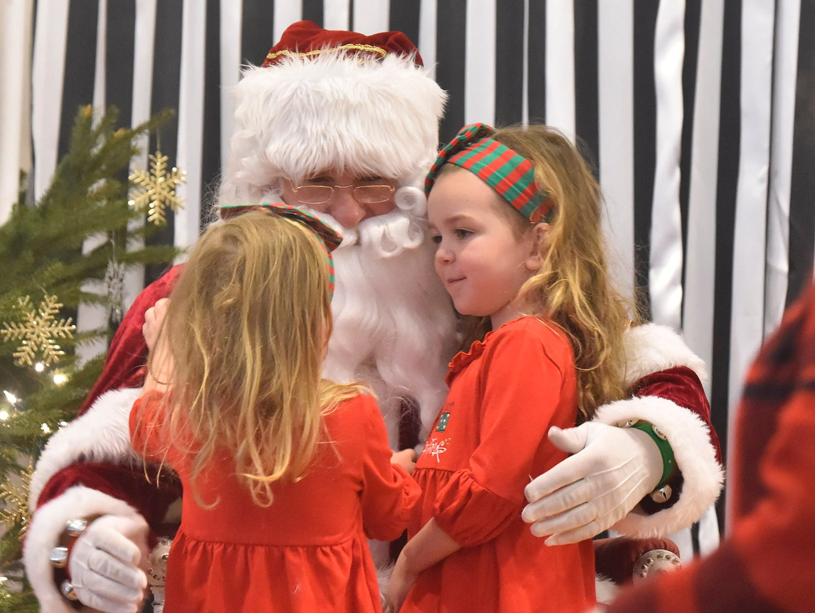 Santa listens to the wish lists of Breya and Mirabella Coyne of Sturgeon Bay during Christmas in the Village in Ephraim on Saturday, Dec. 1, 2018. Tina M. Gohr/USA TODAY NETWORK-Wisconsin