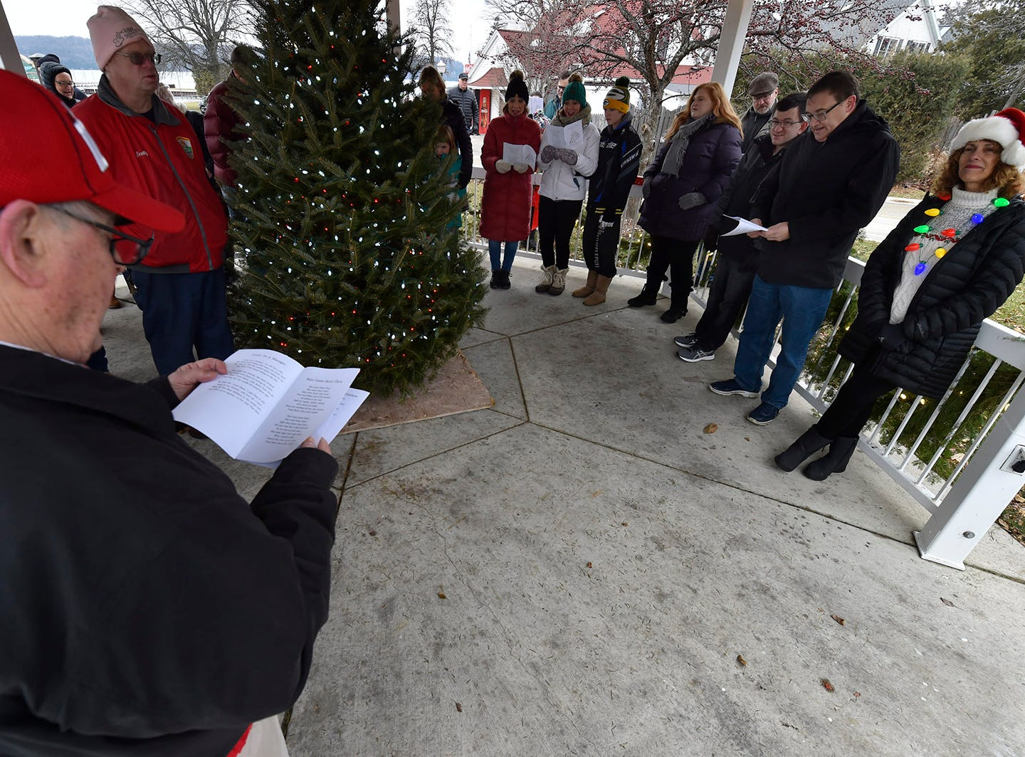 Following the tree-lighting ceremony, the group sang Christmas carols during Christmas in the Village in Ephraim on Saturday, Dec. 1, 2018. Tina M. Gohr/USA TODAY NETWORK-Wisconsin