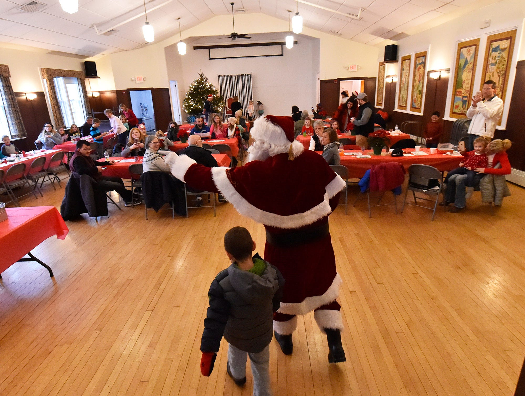 To everybody's delight, Santa makes his grand entrance at Village Hall during Christmas in the Village in Ephraim on Saturday, Dec. 1, 2018. Tina M. Gohr/USA TODAY NETWORK-Wisconsin