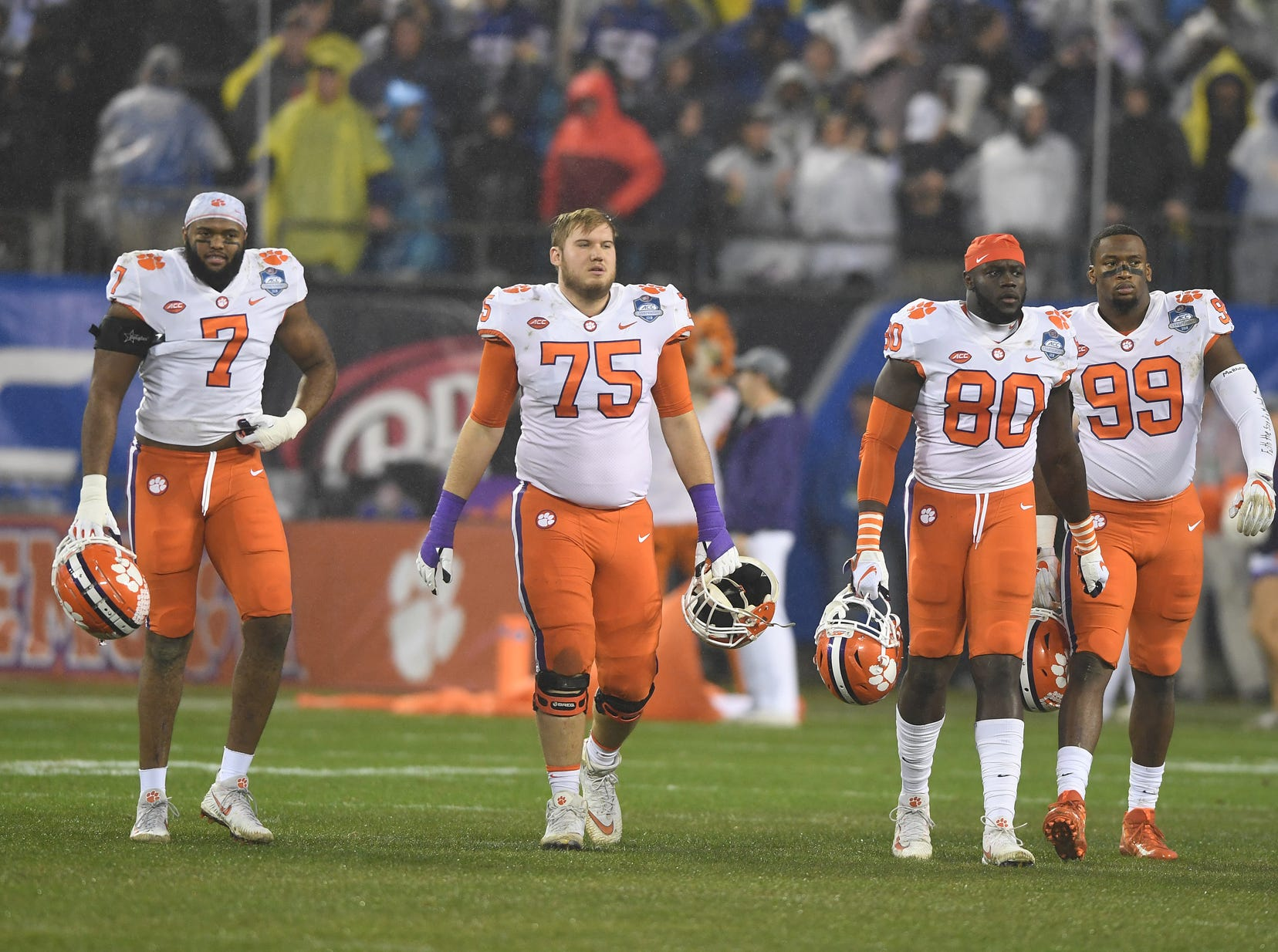 Clemson captions defensive lineman Austin Bryant (7), offensive lineman Mitch Hyatt (75), tight end Milan Richard (80), and defensive lineman Clelin Ferrell (99) during pregame of the Dr. Pepper ACC Championship at Bank of America Stadium in Charlotte, N.C. Saturday, December 1, 2018.