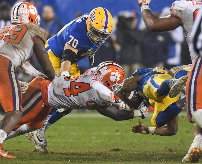 Clemson linebacker Kendall Joseph (34) brings down Pittsburgh running back Qadree Ollison (30) during the 2nd quarter of the Dr. Pepper ACC Championship at Bank of America Stadium in Charlotte, N.C. Saturday, December 1, 2018.