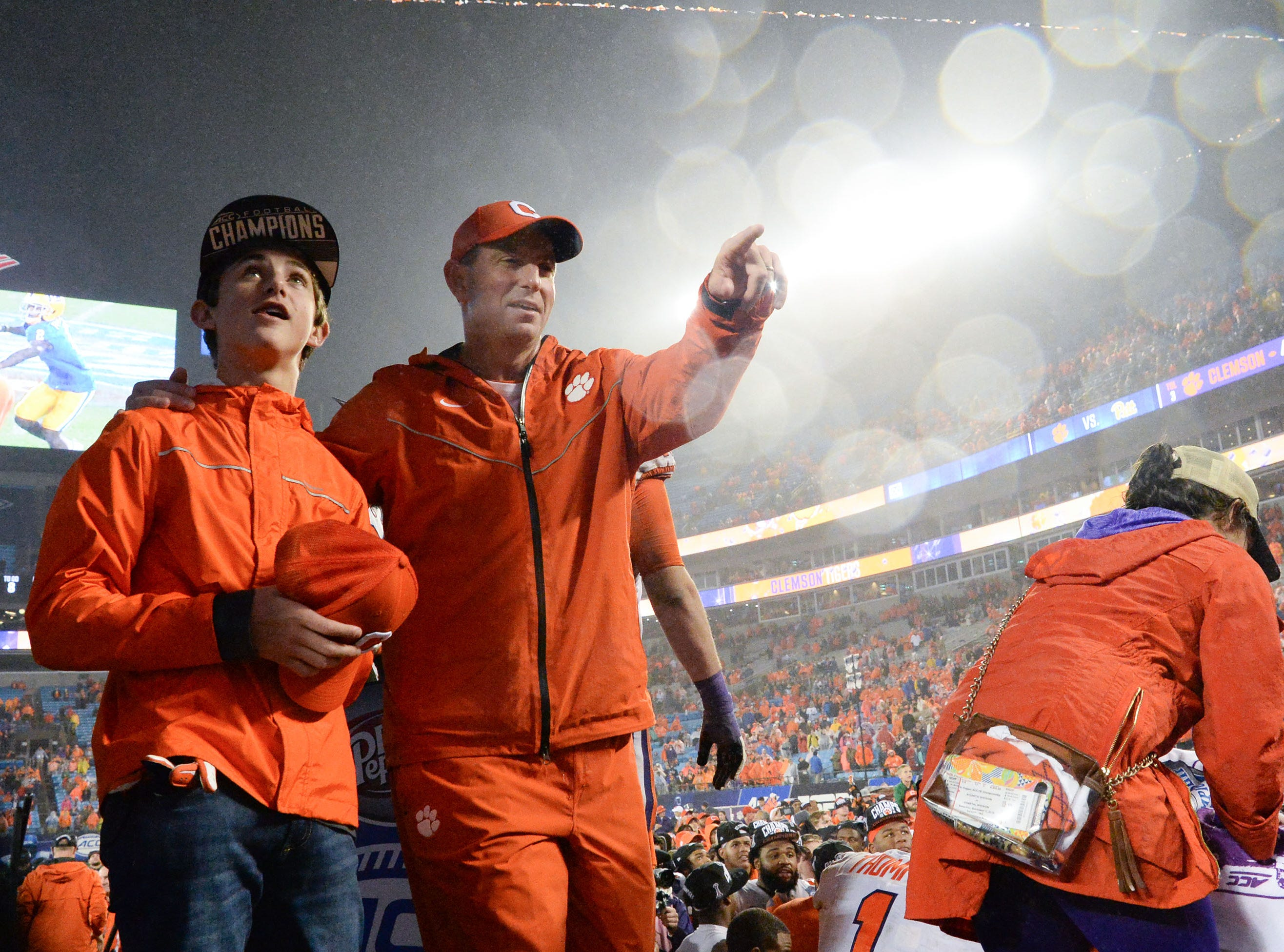 Clay Swinney and his father Clemson Head Coach Dabo Swinney after a 42-10 win after the game at the Dr. Pepper ACC football championship at Bank of America Stadium in Charlotte, N.C. on Saturday, December 1, 2018.