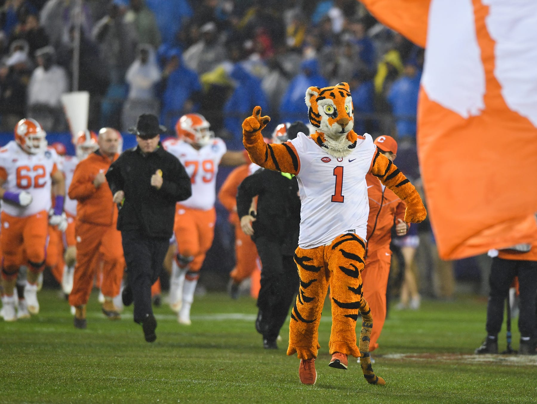 Clemson runs onto the field during pregame of the Dr. Pepper ACC Championship at Bank of America Stadium in Charlotte, N.C. Saturday, December 1, 2018.
