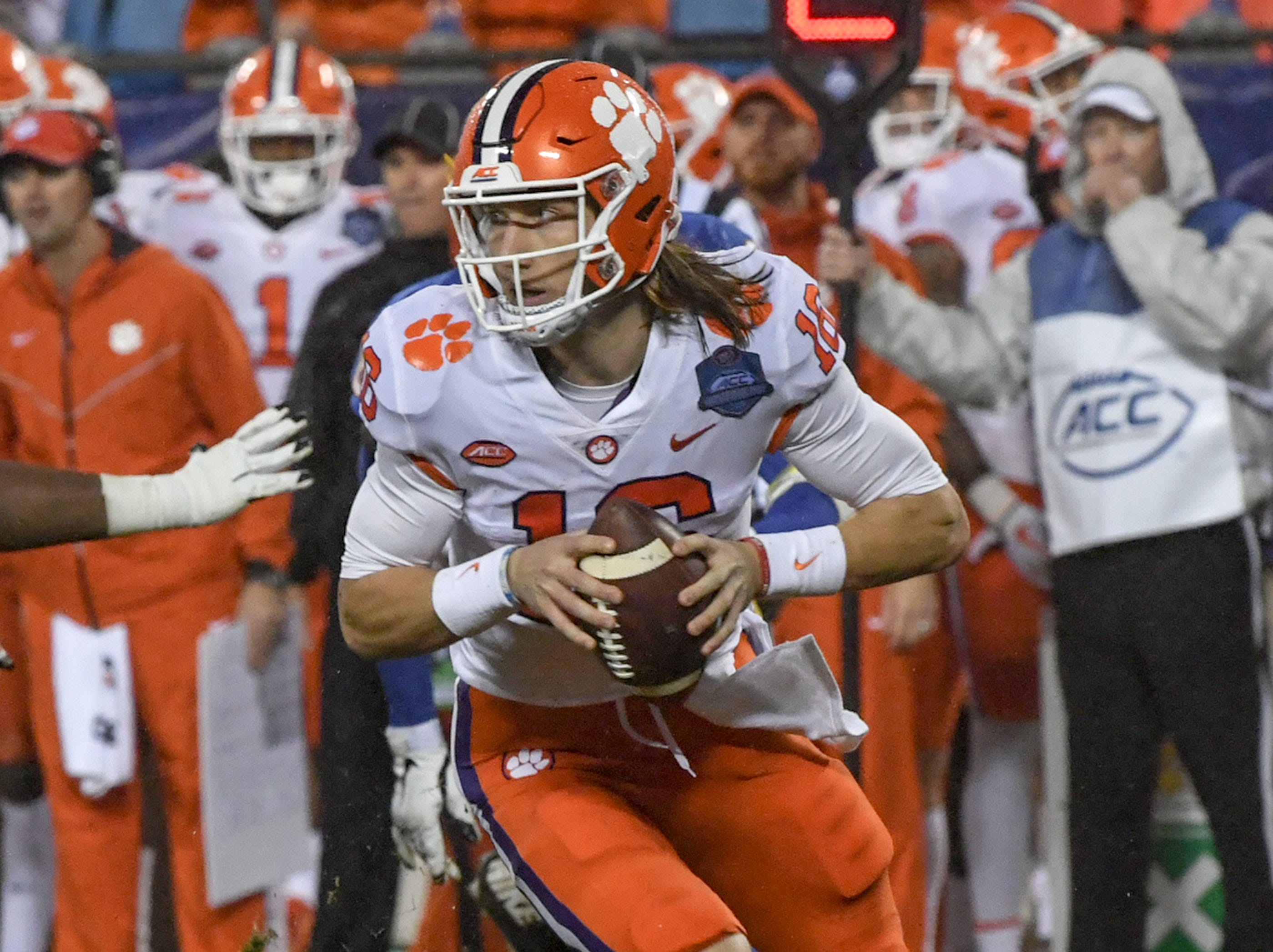 Clemson quarterback Trevor Lawrence (16) rolls out to pass against Pittsburgh during the second quarter of the Dr. Pepper ACC football championship at Bank of America Stadium in Charlotte, N.C. on Saturday, December 1, 2018.
