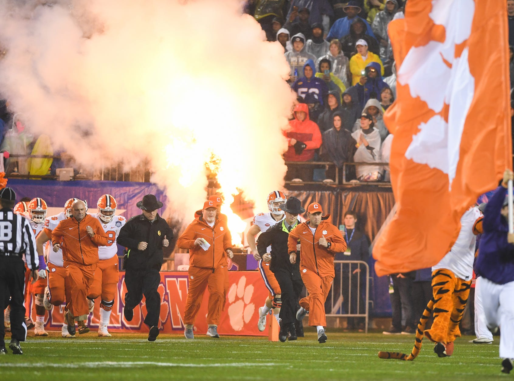 Clemson head coach Dabo Swinney leads his team onto the field during pregame of the Dr. Pepper ACC Championship at Bank of America Stadium in Charlotte, N.C. Saturday, December 1, 2018.