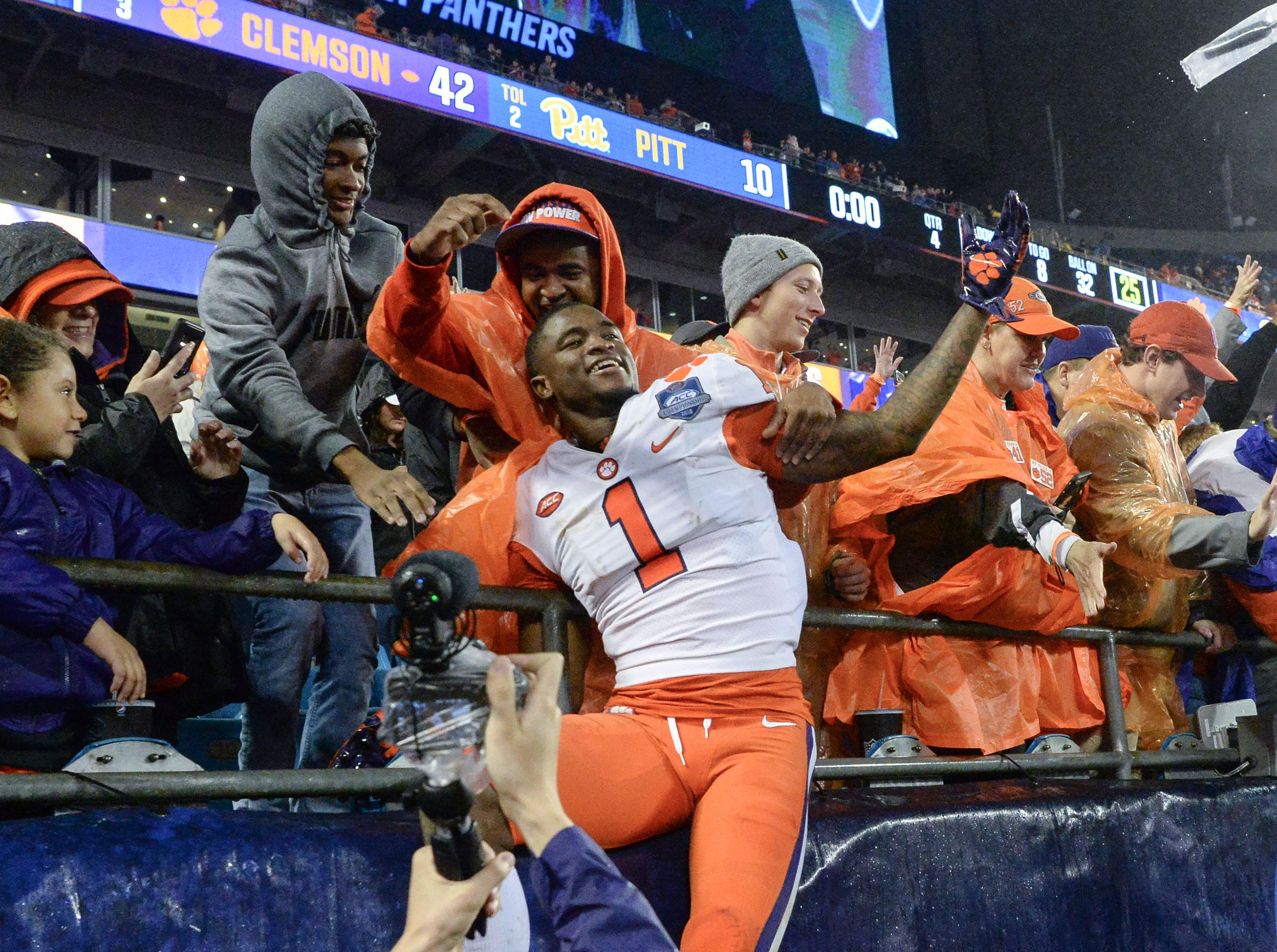 Clemson cornerback Trayvon Mullen (1) celebrates with fans a 42-10 win over Pittsburgh after the game at the Dr. Pepper ACC football championship at Bank of America Stadium in Charlotte, N.C. on Saturday, December 1, 2018.