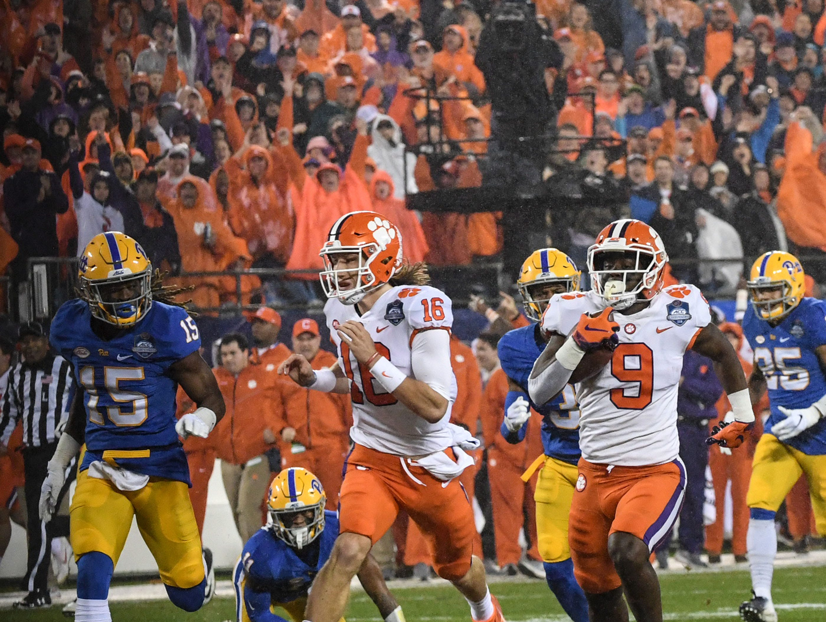 Clemson running back Travis Etienne (9) runs for a 75-yard touchdown against Pittsburgh during the first quarter of the Dr. Pepper ACC football championship at Bank of America Stadium in Charlotte, N.C. on Saturday, December 1, 2018.