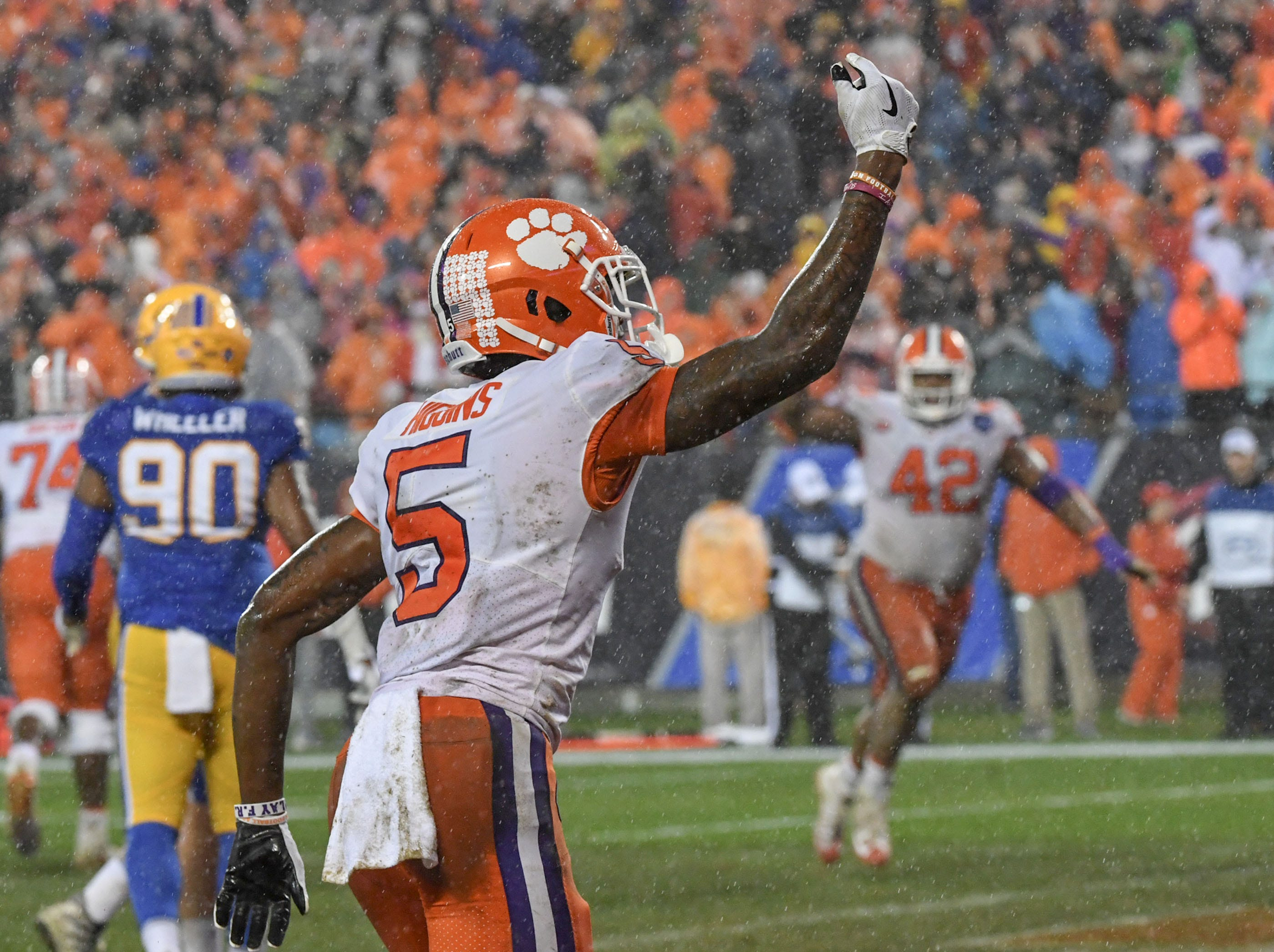 Clemson wide receiver Tee Higgins (5) reacts after catching a touchdown against Pittsburgh during the second quarter of the Dr. Pepper ACC football championship at Bank of America Stadium in Charlotte, N.C. on Saturday, December 1, 2018.