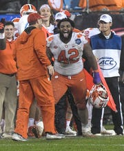 Clemson defensive lineman Christian Wilkins (42) reacts after Clemson Head Coach Dabo Swinney was doused with a bucket of Gatorade in the closing minute during the fourth quarter in Memorial Stadium on Saturday, November 3, 2018.
