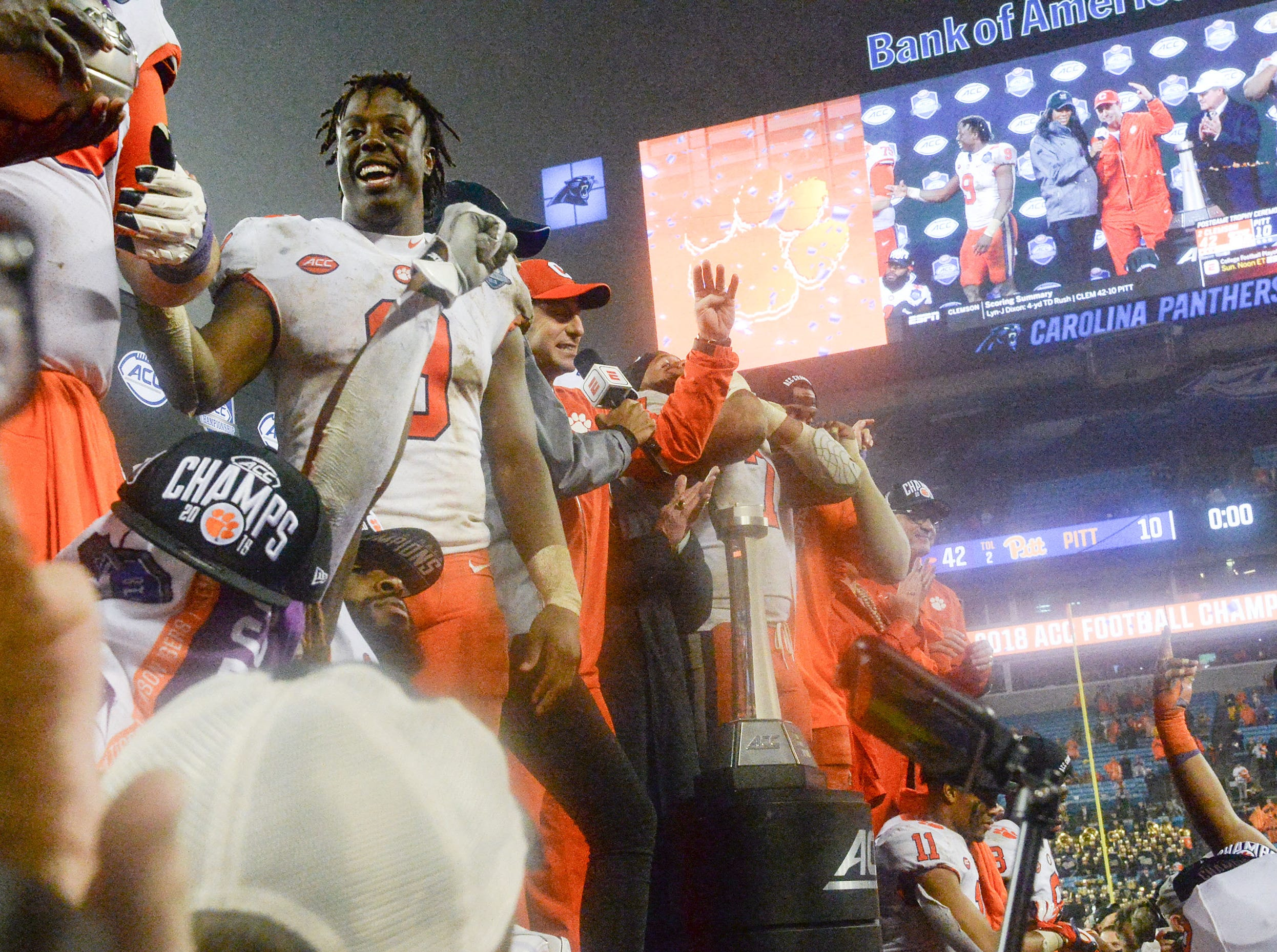Clemson running back Travis Etienne, game MVP, and fans celebrate a 42-10 win over Pittsburgh after the game at the Dr. Pepper ACC football championship at Bank of America Stadium in Charlotte, N.C. on Saturday, December 1, 2018.