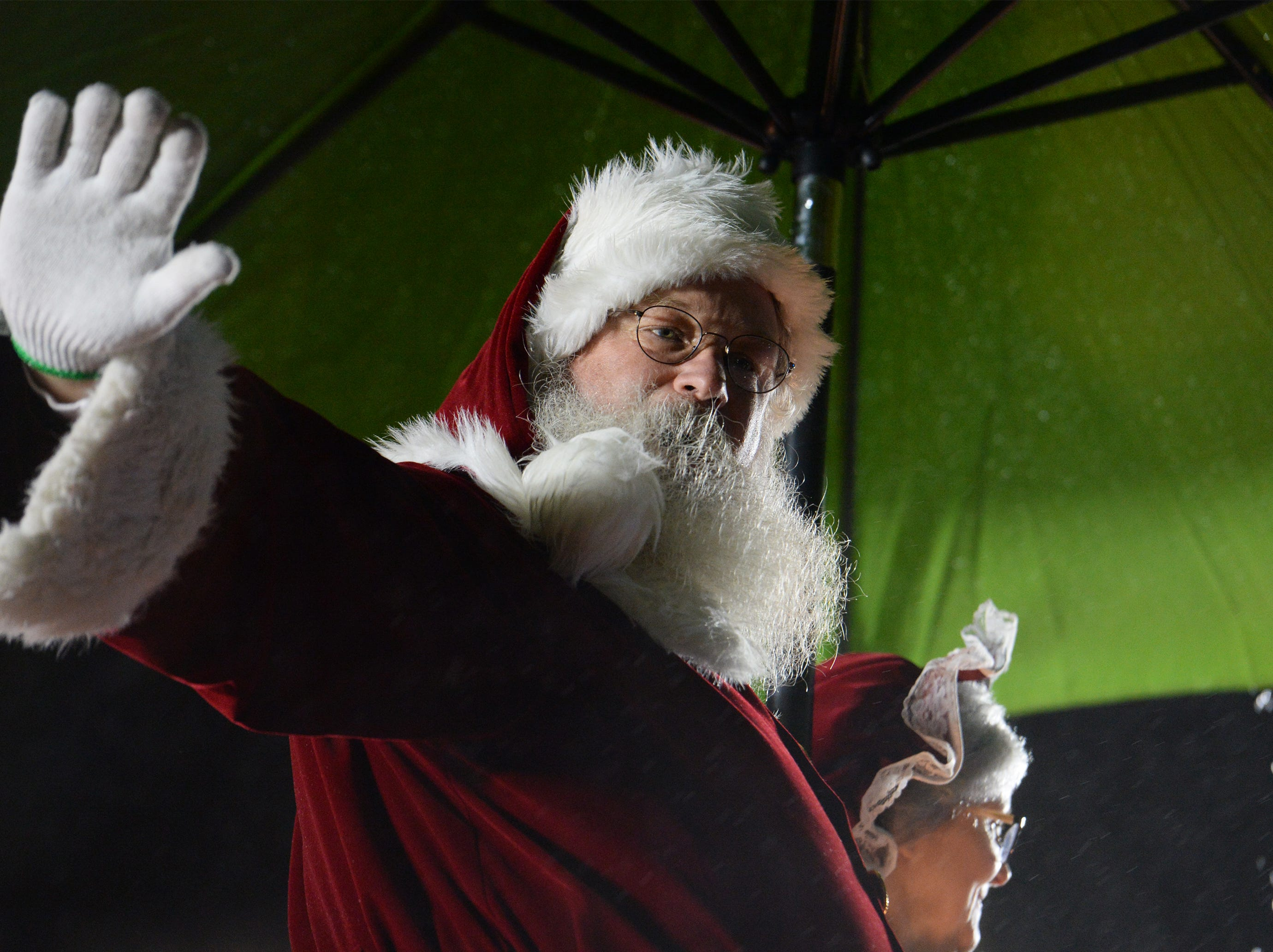Santa waves to the crowd during the Greenville Poinsettia Christmas Parade Saturday, Dec. 1, 2018 in downtown Greenville.