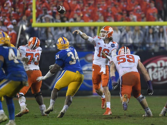 Clemson quarterback Trevor Lawrence (16) passes against Pittsburgh during the 4th quarter of the Dr. Pepper ACC Championship at Bank of America Stadium in Charlotte, N.C. Saturday, December 1, 2018.