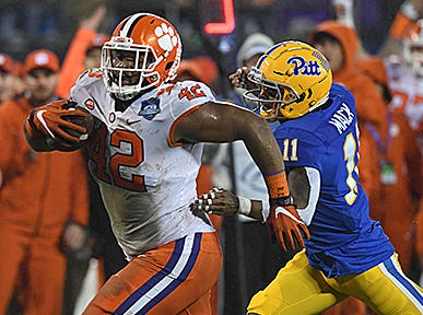 Clemson defensive lineman Christian Wilkins (42) returns a Pittsburgh interception to the 1 yard line during the 1st quarter of the Dr. Pepper ACC Championship at Bank of America Stadium in Charlotte, N.C. Saturday, December 1, 2018.