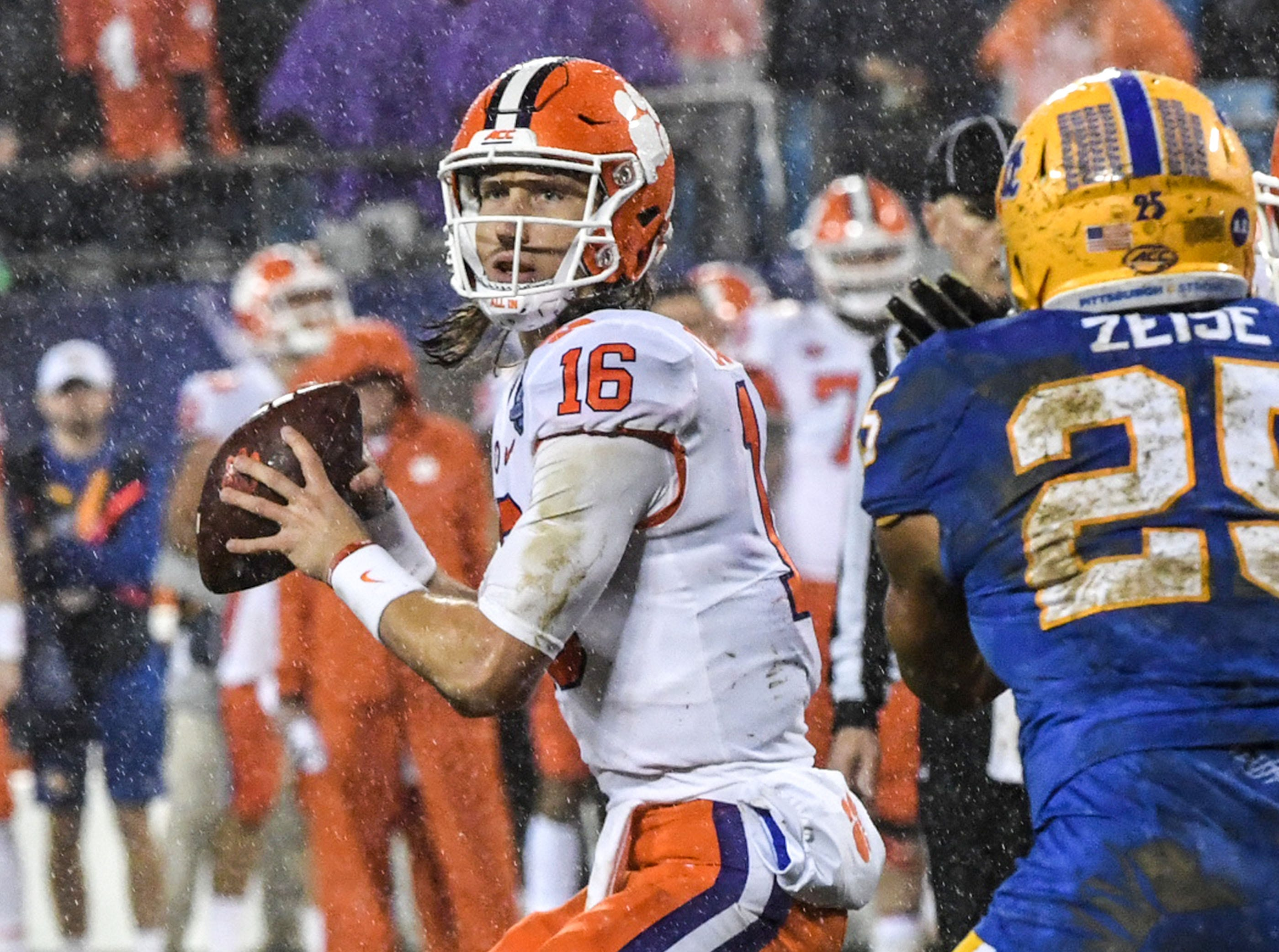 Clemson quarterback Trevor Lawrence (16) passes to wide receiver Tee Higgins (5) for a touchdown against Pittsburgh during the second quarter of the Dr. Pepper ACC football championship at Bank of America Stadium in Charlotte, N.C. on Saturday, December 1, 2018.