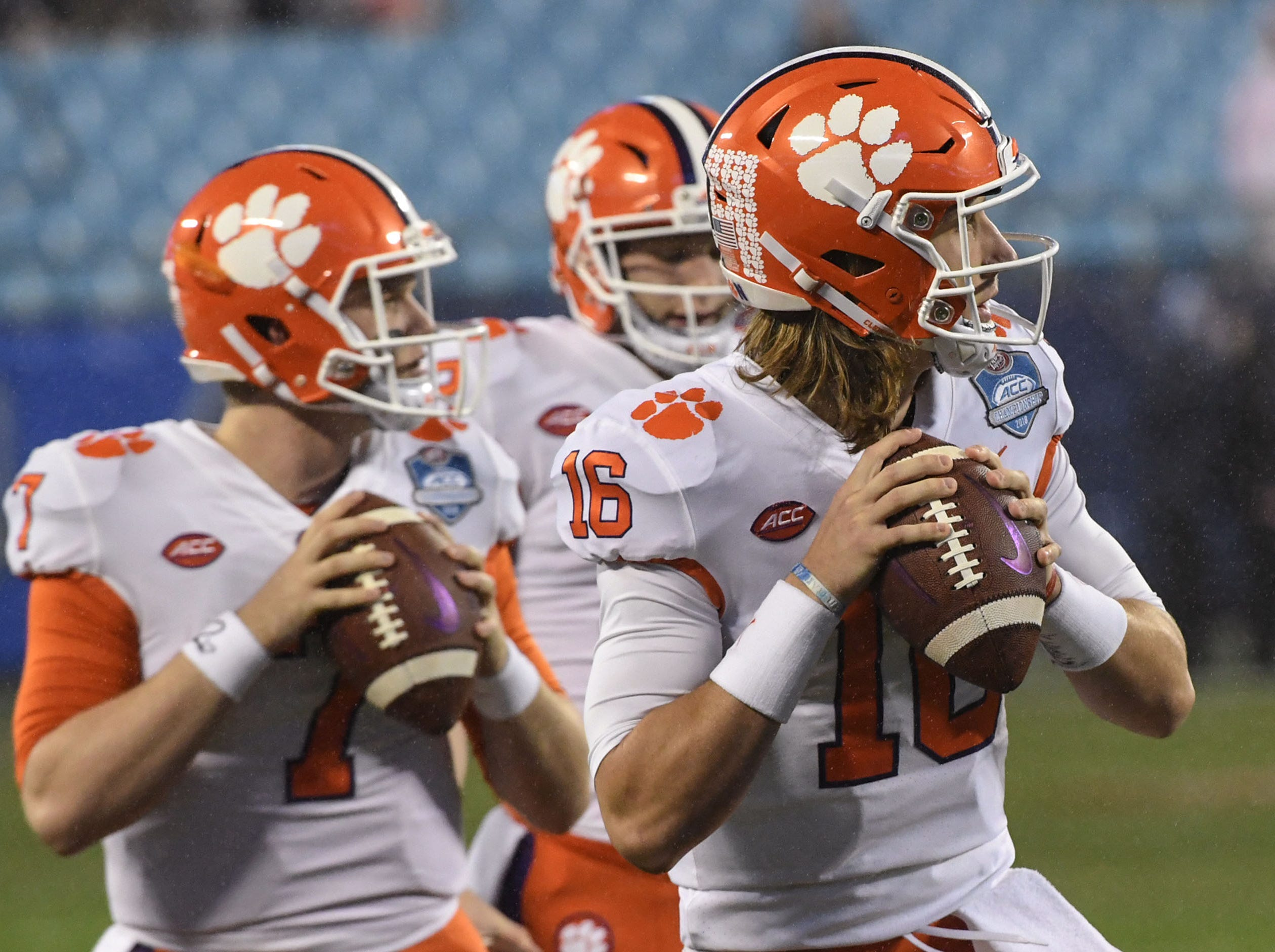 Clemson quarterback Chase Brice (7) and quarterback Trevor Lawrence (16) warm up before the game of the Dr. Pepper ACC football championship at Bank of America Stadium in Charlotte, N.C. on Saturday, December 1, 2018.