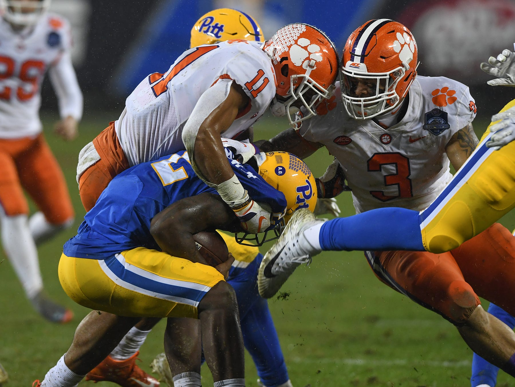 Clemson safety Isaiah Simmons (11) brings down Pittsburgh wide receiver Maurice Ffrench (2) during the 2nd quarter of the Dr. Pepper ACC Championship at Bank of America Stadium in Charlotte, N.C. Saturday, December 1, 2018.