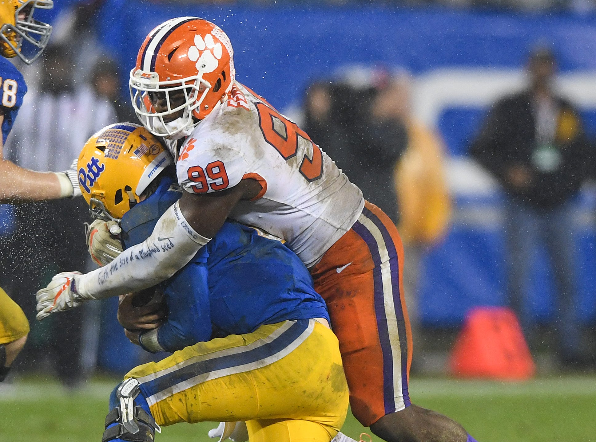 Clemson defensive lineman Clelin Ferrell (99) sacks Pittsburgh quarterback Kenny Pickett (8) during the 2nd quarter of the Dr. Pepper ACC Championship at Bank of America Stadium in Charlotte, N.C. Saturday, December 1, 2018.