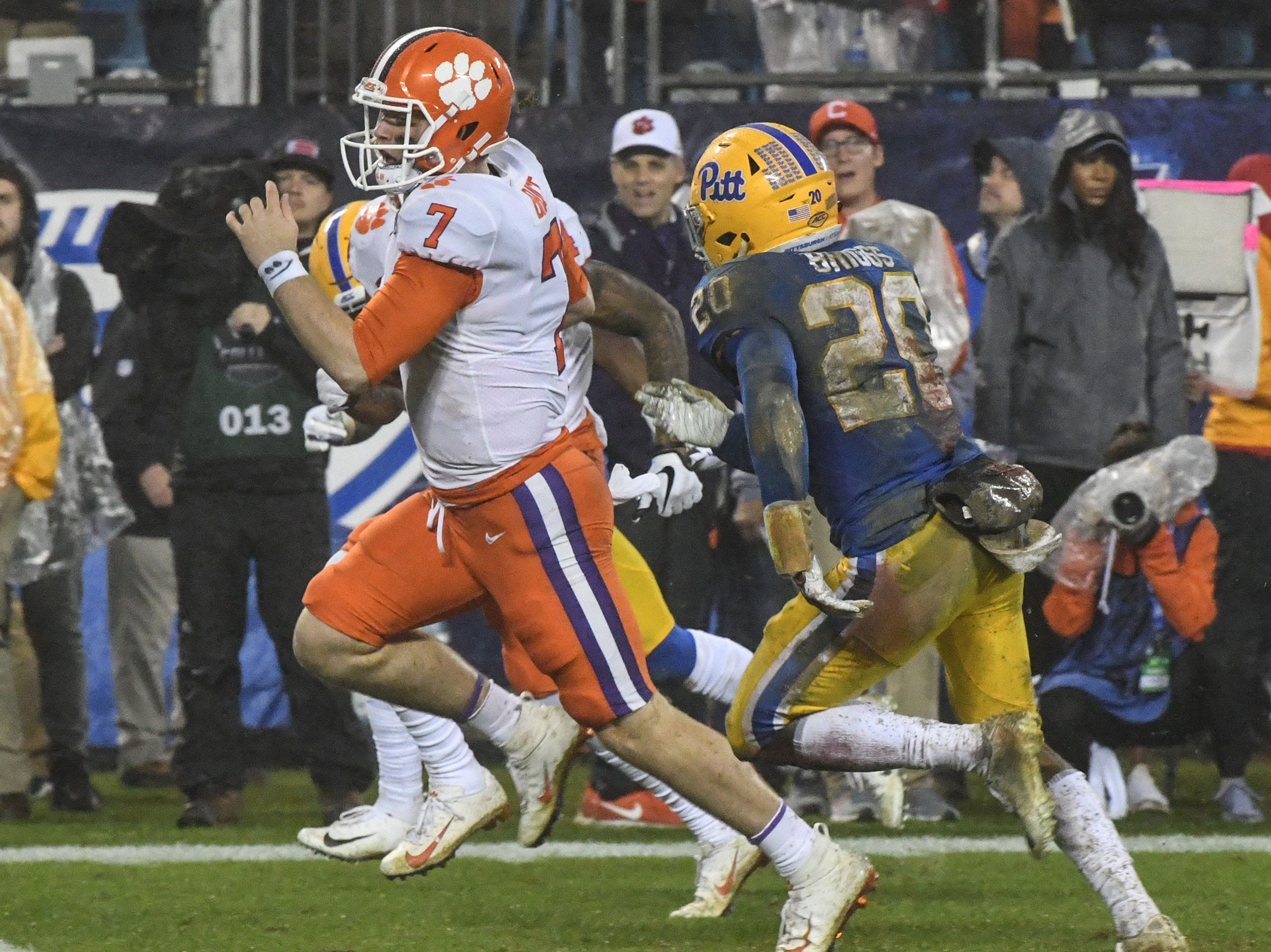 Clemson quarterback Chase Brice (7) runs by Pittsburgh Dennis Briggs during the fourth quarter in Memorial Stadium on Saturday, November 3, 2018.