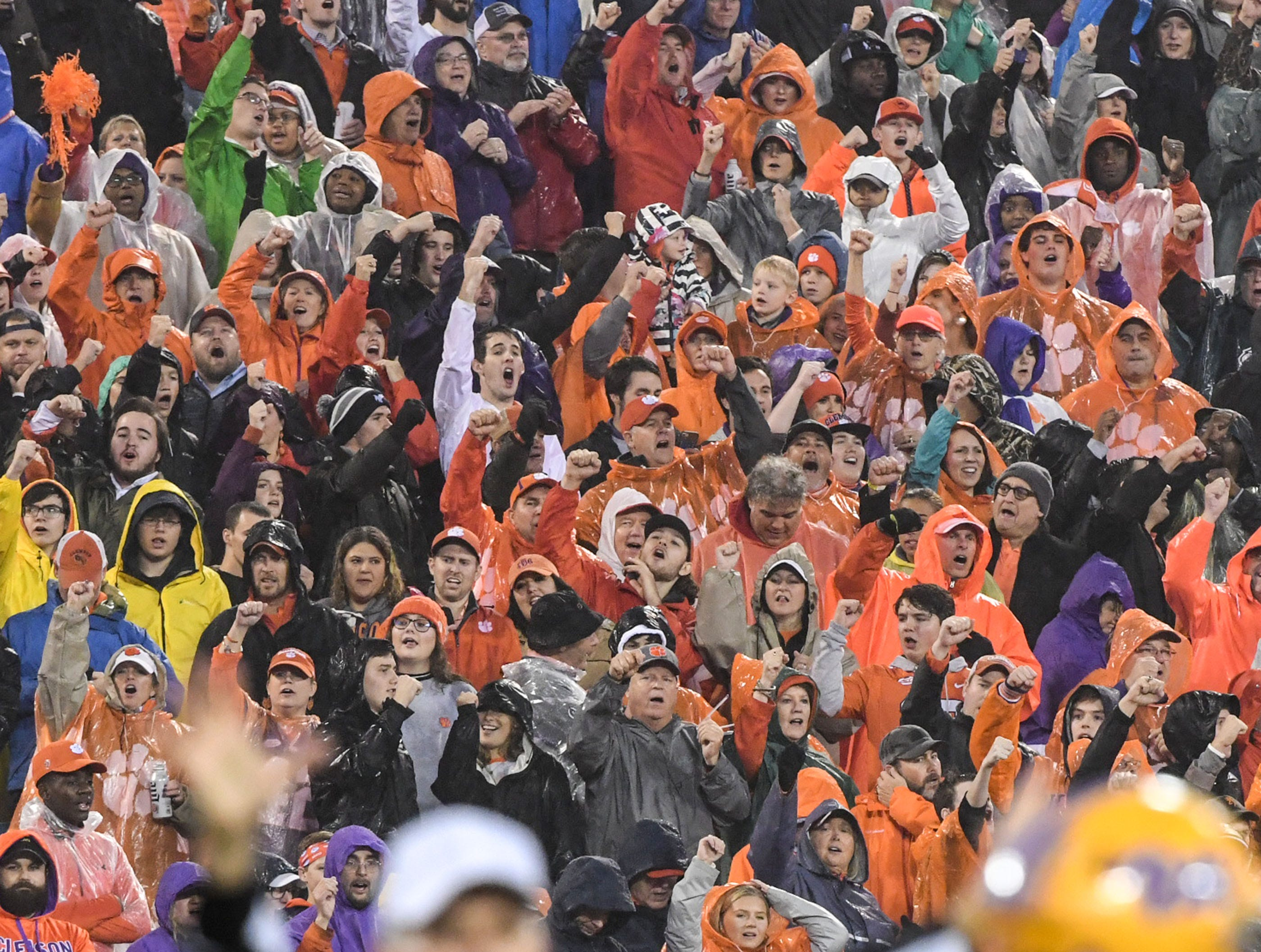 Clemson fans cheer after running back Travis Etienne (9) scored a touchdown during the first quarter of the Dr. Pepper ACC football championship at Bank of America Stadium in Charlotte, N.C. on Saturday, December 1, 2018.