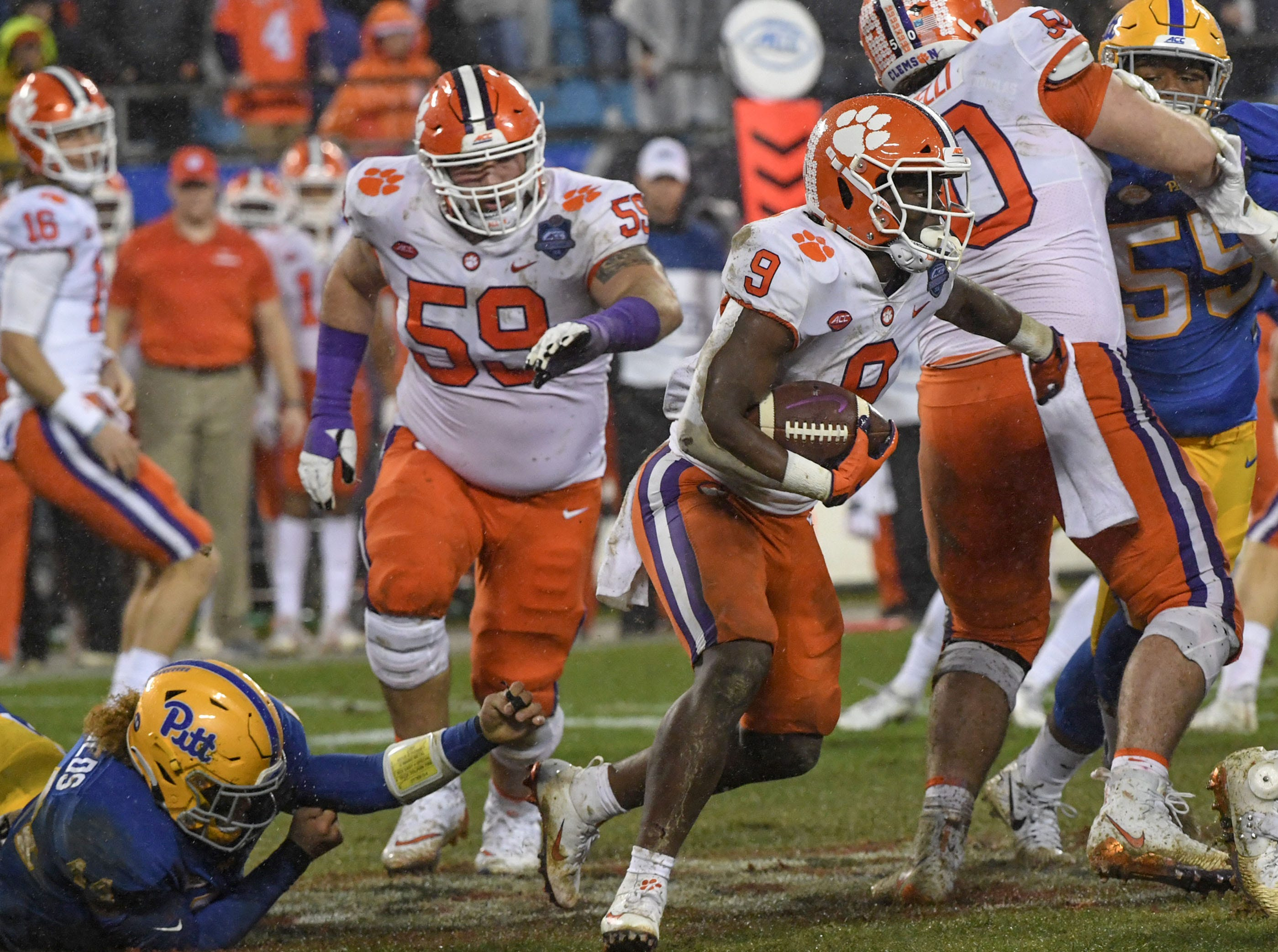Clemson running back Travis Etienne (9) runs during the second quarter of the Dr. Pepper ACC football championship at Bank of America Stadium in Charlotte, N.C. on Saturday, December 1, 2018.