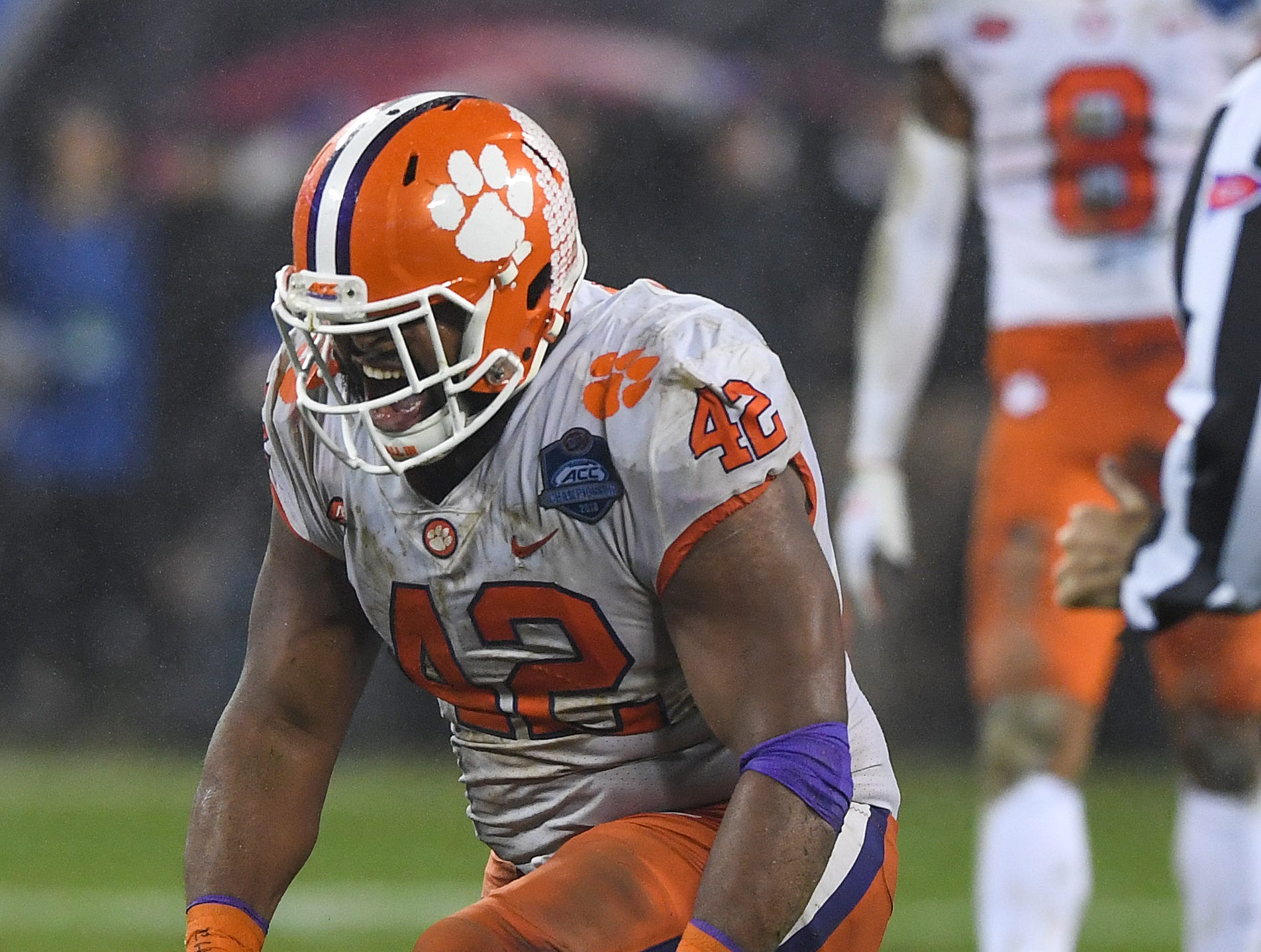 Clemson defensive lineman Christian Wilkins (42) reacts after tackling Pittsburgh running back Darrin Hall (22) during the 3rd quarter of the Dr. Pepper ACC Championship at Bank of America Stadium in Charlotte, N.C. Saturday, December 1, 2018.