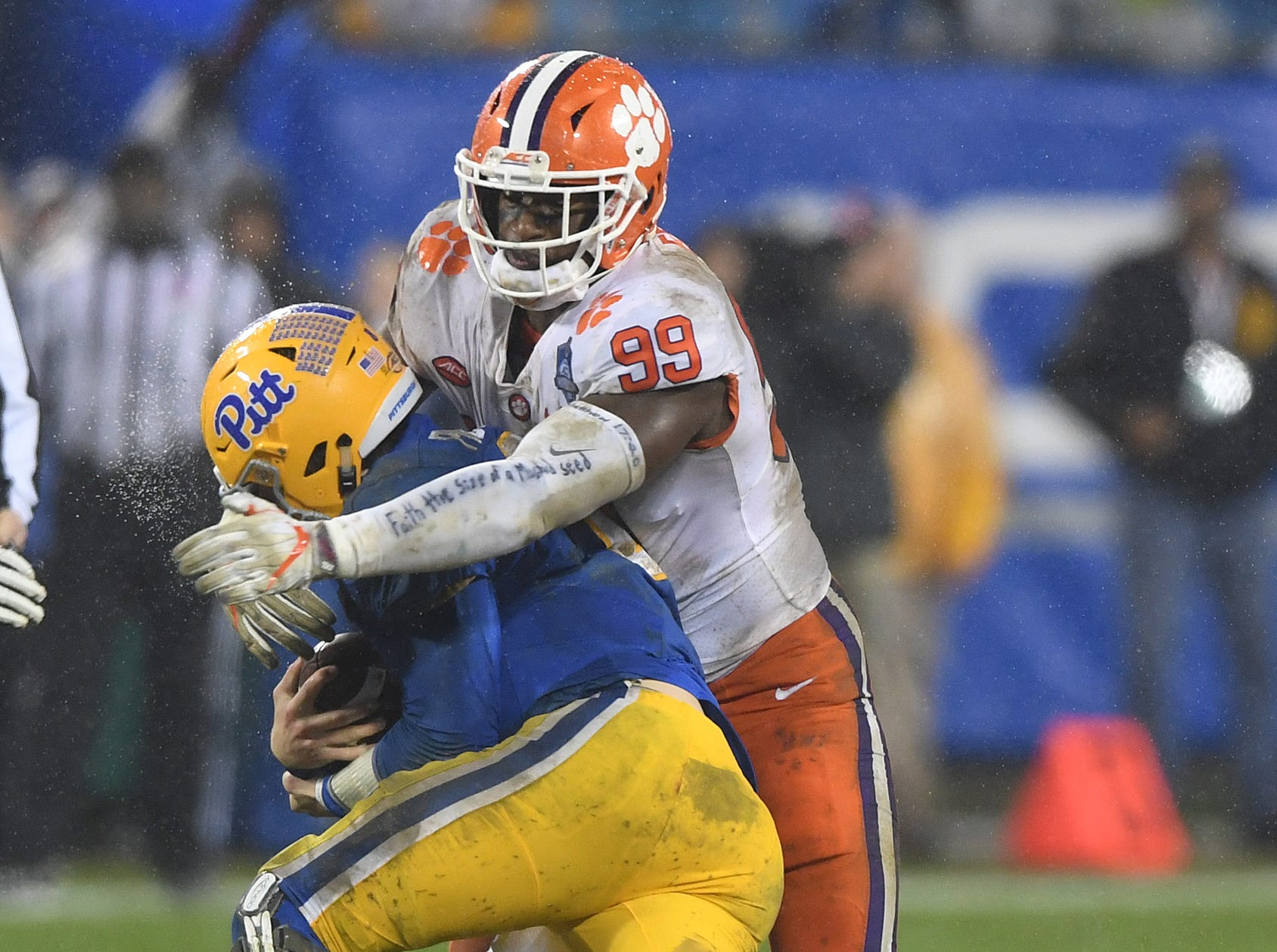 Clemson defensive lineman Clelin Ferrell (99) sacks Pittsburgh quarterback Kenny Pickett (8) during the 2nd quarter of the Dr. Pepper ACC Championship at Bank of America Stadium in Charlotte, N.C. Saturday, December 1, 2017.