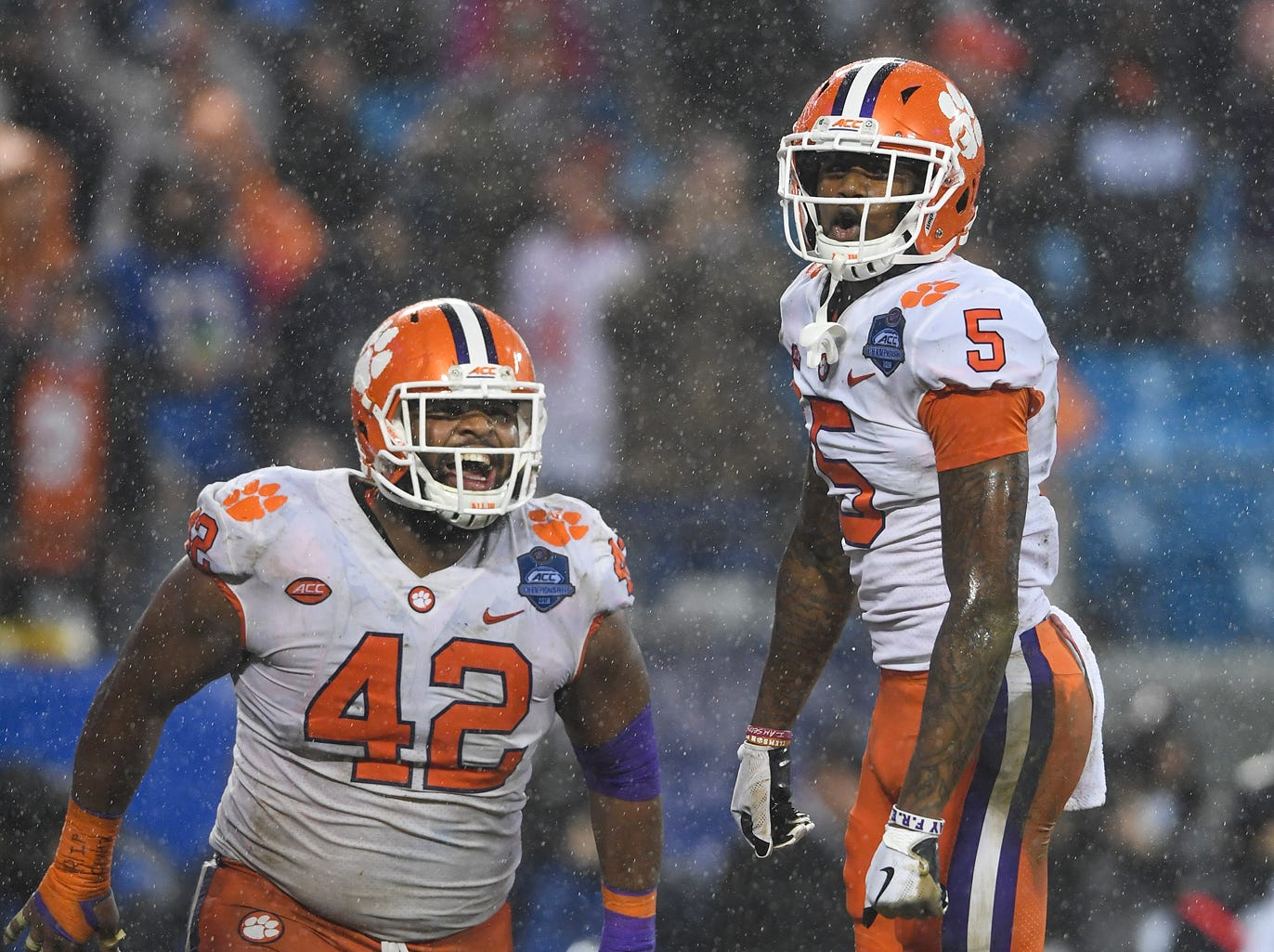 Clemson wide receiver Tee Higgins (5) celebrates with defensive lineman Christian Wilkins (42) after catching a TD against Pittsburgh during the 2nd quarter of the Dr. Pepper ACC Championship at Bank of America Stadium in Charlotte, N.C. Saturday, December 1, 2018.