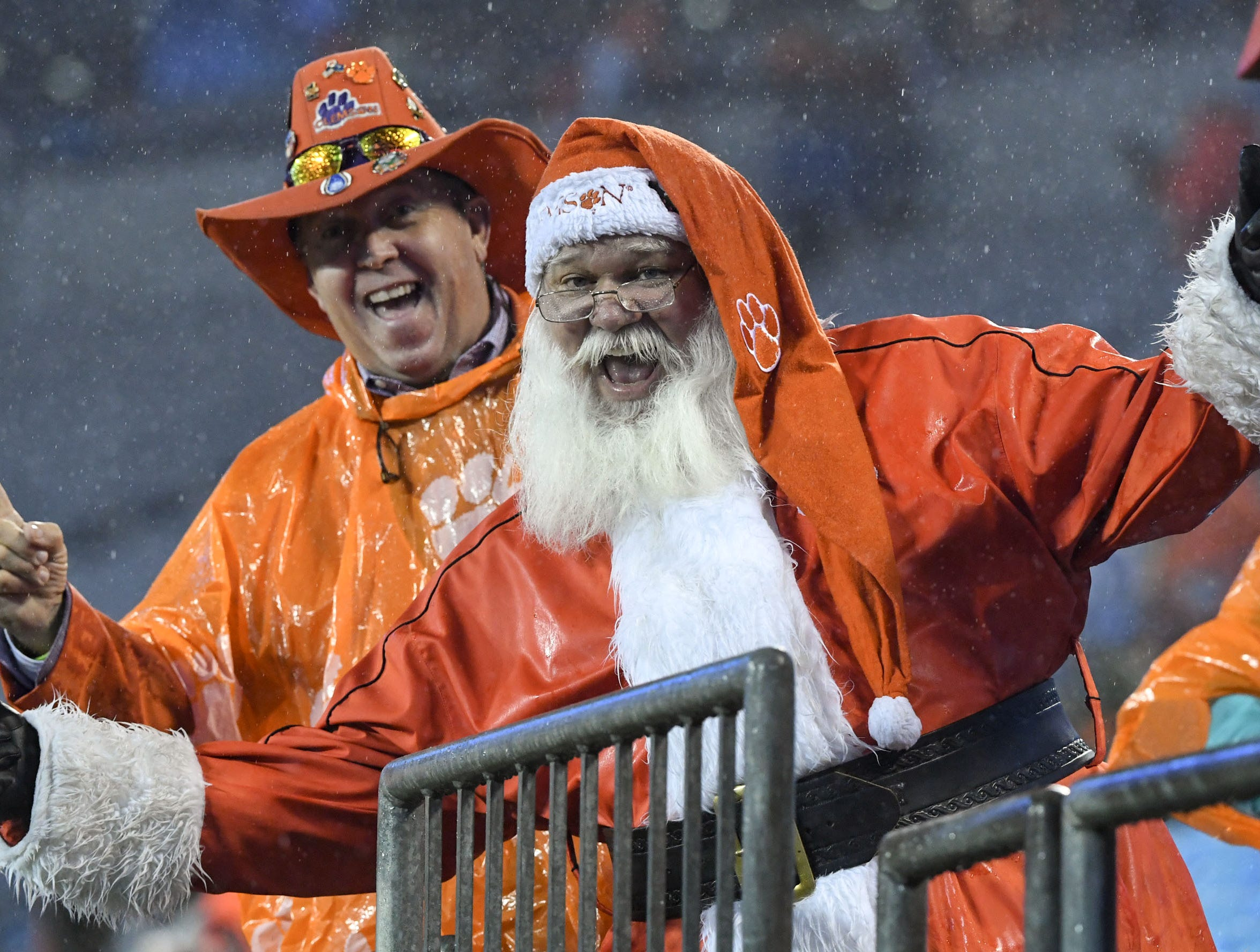 "Dean ""The Hat"" Cox and Santa Paws before the game of the Dr. Pepper ACC football championship at Bank of America Stadium in Charlotte, N.C. on Saturday, December 1, 2018."