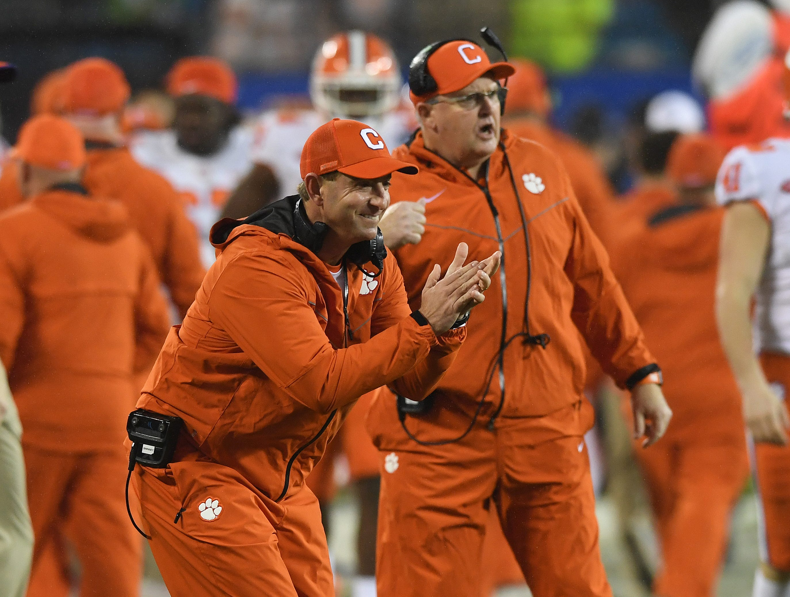 Clemson head coach Dabo Swinney reacts after running back Travis Etienne (9) raced 75 yards to score against Pittsburgh on the Tigers first play from scrimmage during the 1st quarter of the Dr. Pepper ACC Championship at Bank of America Stadium in Charlotte, N.C. Saturday, December 1, 2018.