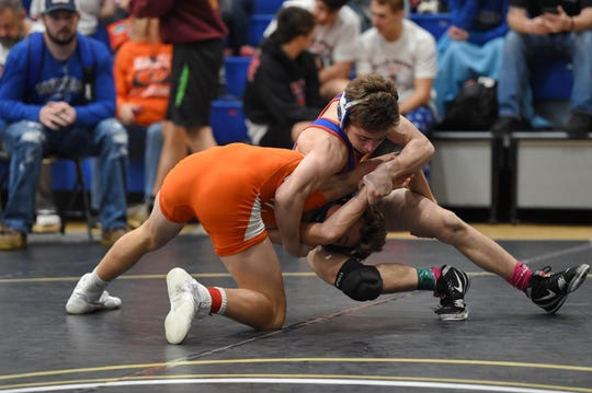 Byrnes' Chris Thompson, right, wrestles Mauldin's Thomas Snipes in the 113-pound weight class in Saturday's Southern Slam Invitational at Eastside High School.