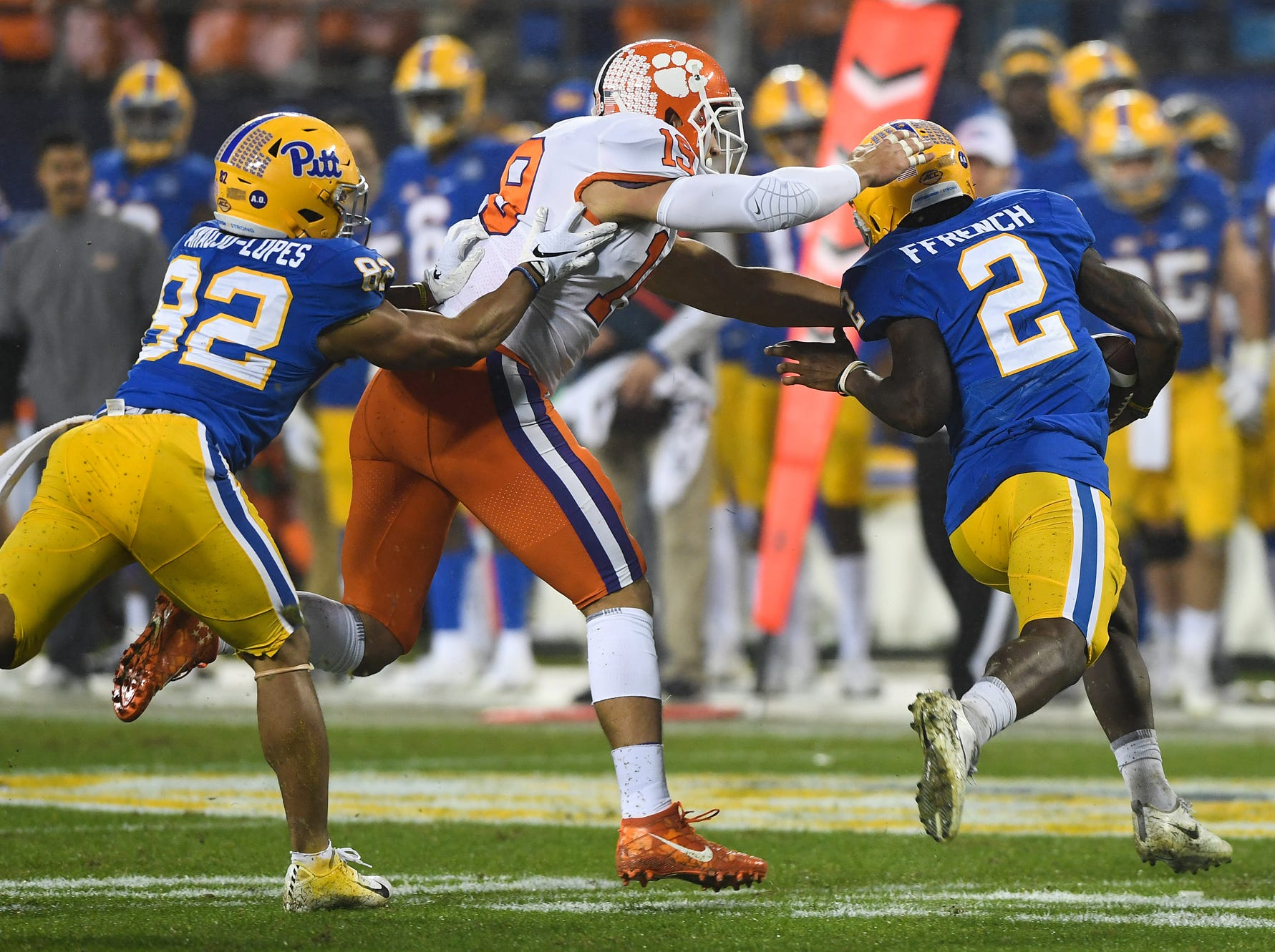 Clemson defensive back Tanner Muse (19) tries to stop Pittsburgh wide receiver Maurice Ffrench (2) during the 1st quarter of the Dr. Pepper ACC Championship at Bank of America Stadium in Charlotte, N.C. Saturday, December 1, 2018.