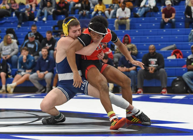 Eastside's Bryson Ethington, left, wrestles Woodward Academy's McCoy Pace in the 152-pound weight class in Saturday's Southern Slam Invitational at Eastside High School.