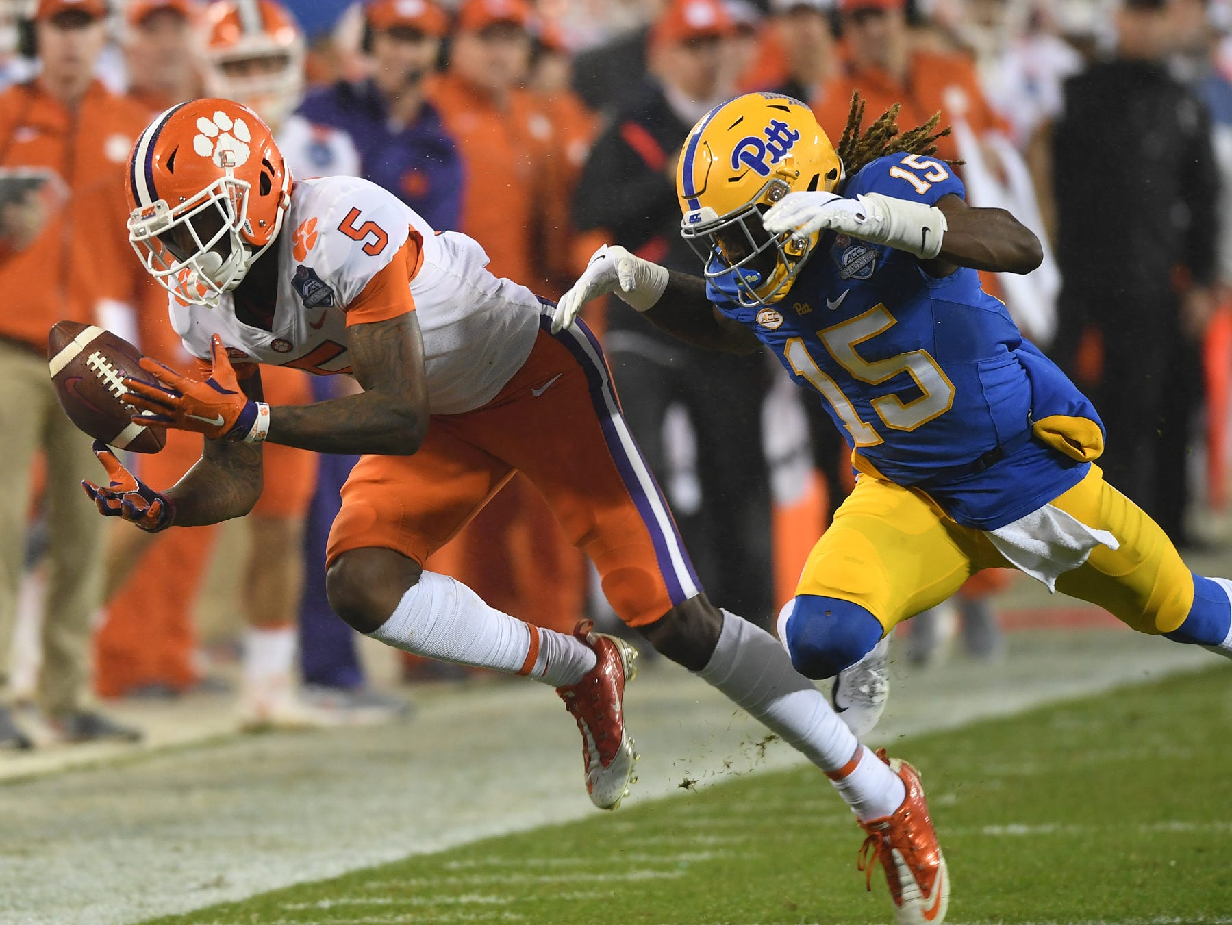 Clemson wide receiver Tee Higgins (5) can't come down with a pass while being defended by Pittsburgh defensive back Jason Pinnock (15) during the 1st quarter of the Dr. Pepper ACC Championship at Bank of America Stadium in Charlotte, N.C. Saturday, December 1, 2018.