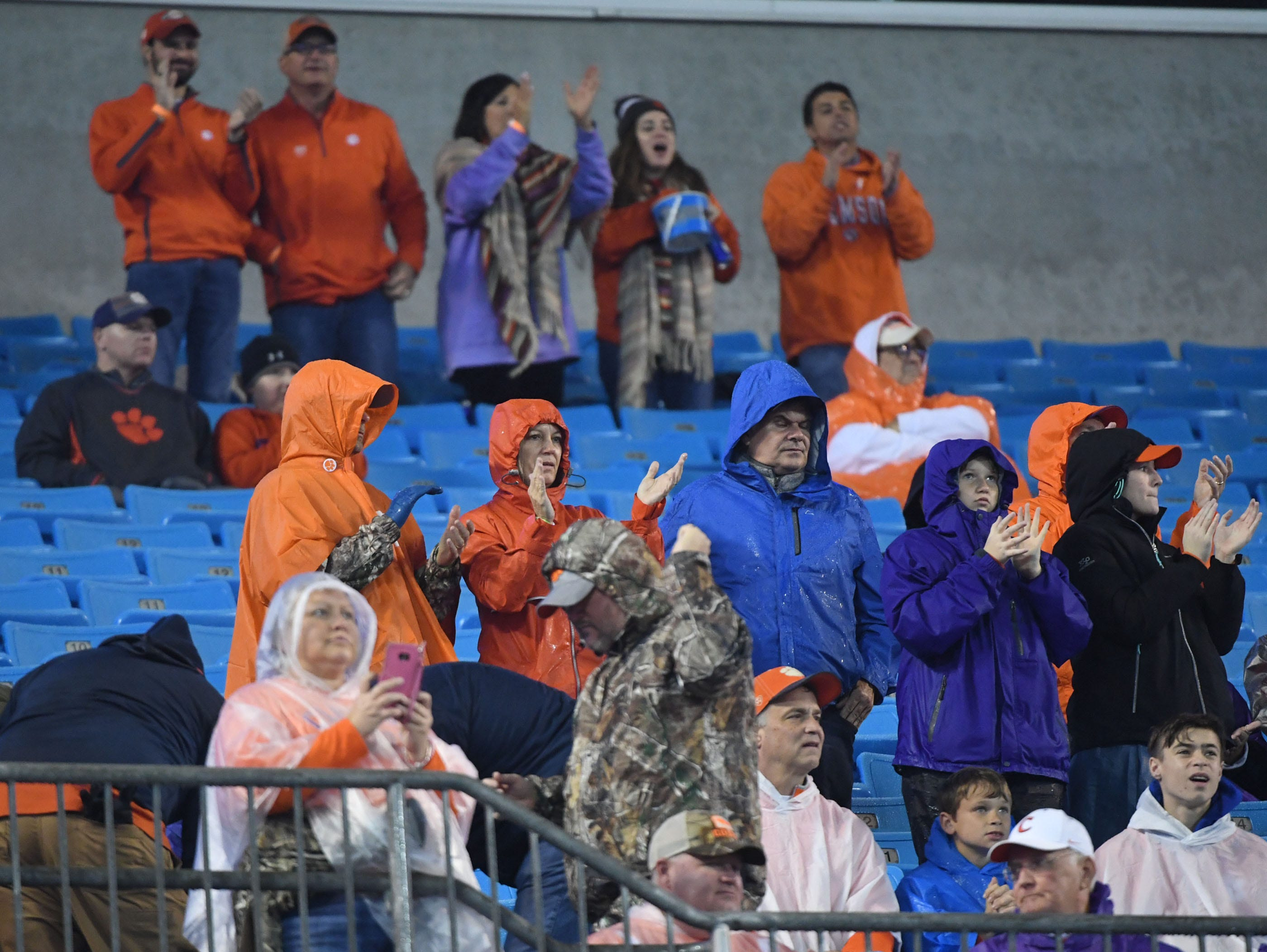 Clemson fans cheer before the game of the Dr. Pepper ACC football championship at Bank of America Stadium in Charlotte, N.C. on Saturday, December 1, 2018.