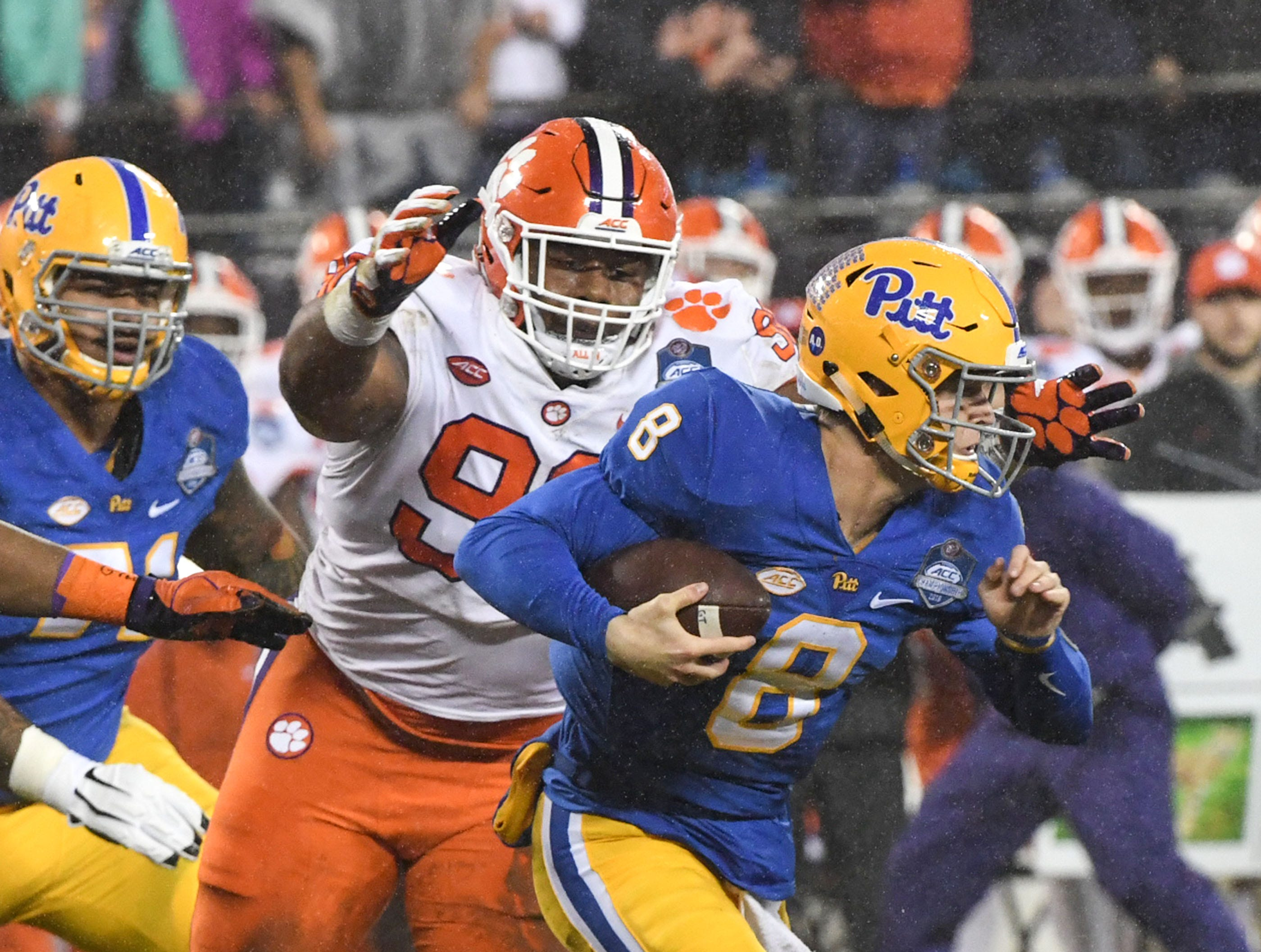 Clemson defensive lineman Dexter Lawrence (90) sacks Pittsburgh quarterback Kenny Pickett (8) during the first quarter of the Dr. Pepper ACC football championship at Bank of America Stadium in Charlotte, N.C. on Saturday, December 1, 2018.