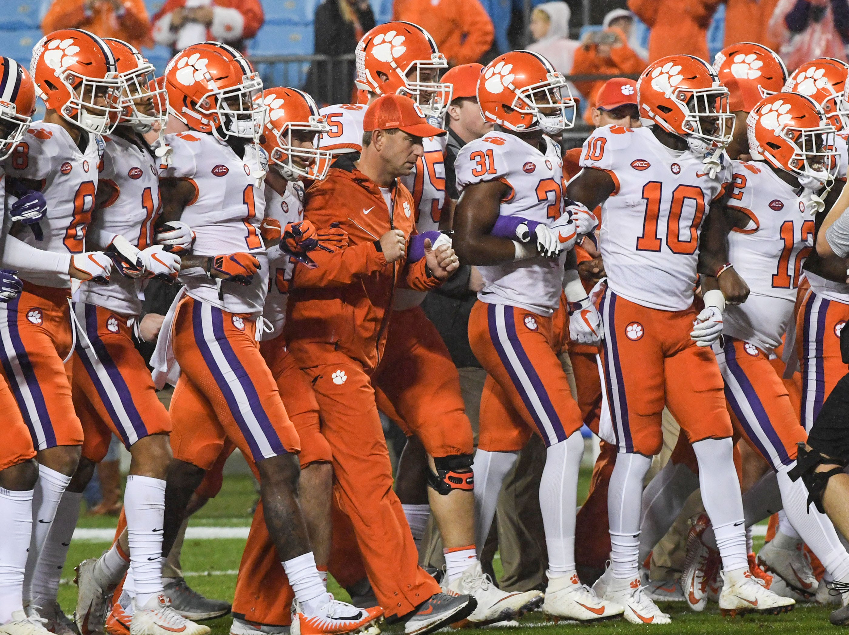 Clemson Head Coach Dabo Swinney walks with players before the game of the Dr. Pepper ACC football championship at Bank of America Stadium in Charlotte, N.C. on Saturday, December 1, 2018.