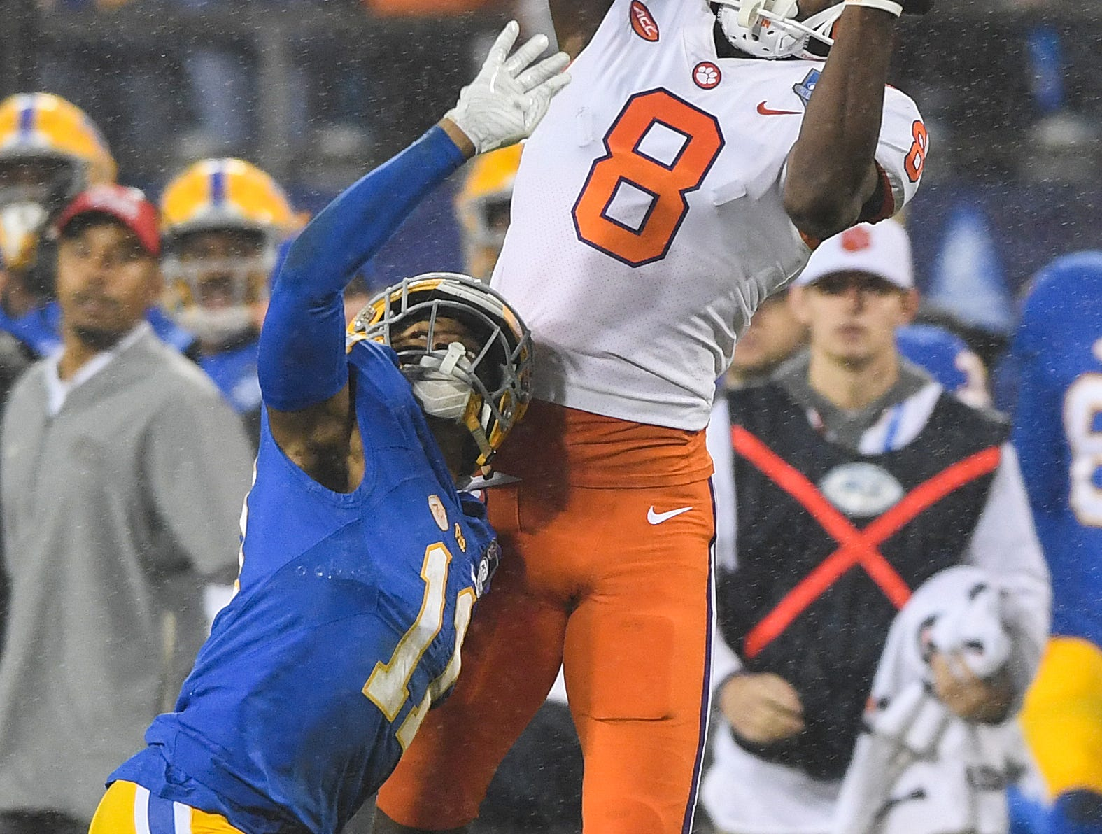 Clemson wide receiver Justyn Ross (8) makes a catch over Pittsburgh defensive back Dane Jackson (11) during the 1st quarter of the Dr. Pepper ACC Championship at Bank of America Stadium in Charlotte, N.C. Saturday, December 1, 2018.