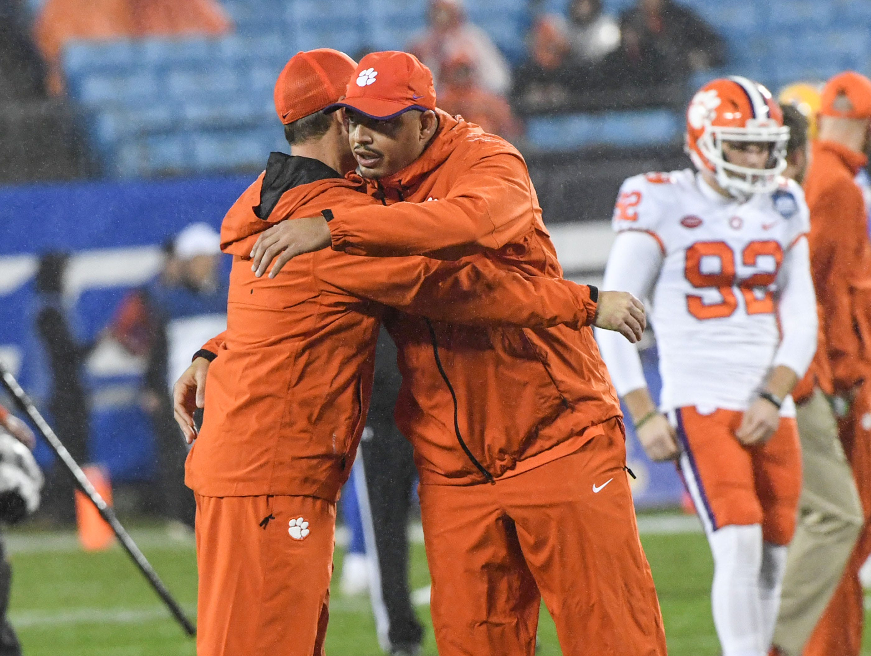 Clemson Head Coach Dabo Swinney and co-offensive coordinator Tony Elliott hug before the game of the Dr. Pepper ACC football championship at Bank of America Stadium in Charlotte, N.C. on Saturday, December 1, 2018.