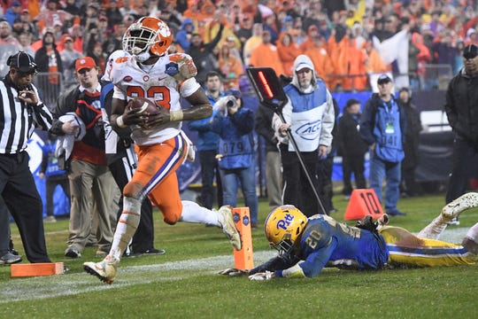 Clemson running back Lyn-J Dixon (23) scores past Pittsburgh defensive back Dennis Briggs (20) during the 4th quarter of the Dr. Pepper ACC Championship at Bank of America Stadium in Charlotte, N.C. Saturday, December 1, 2018.