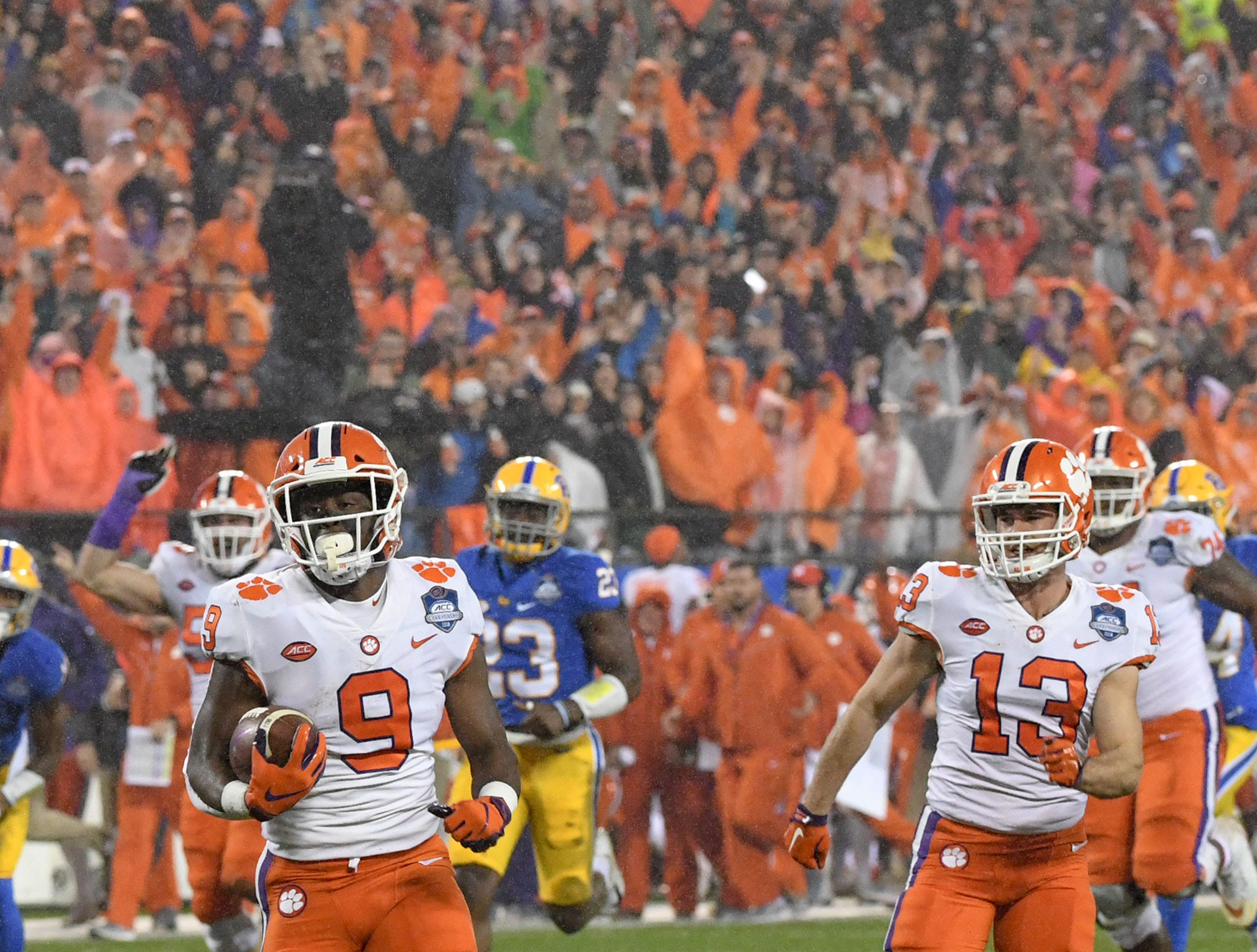 Clemson running back Travis Etienne (9) runs 75 yards for a touchdown against Pittsburgh during the first quarter of the Dr. Pepper ACC football championship at Bank of America Stadium in Charlotte, N.C. on Saturday, December 1, 2018.