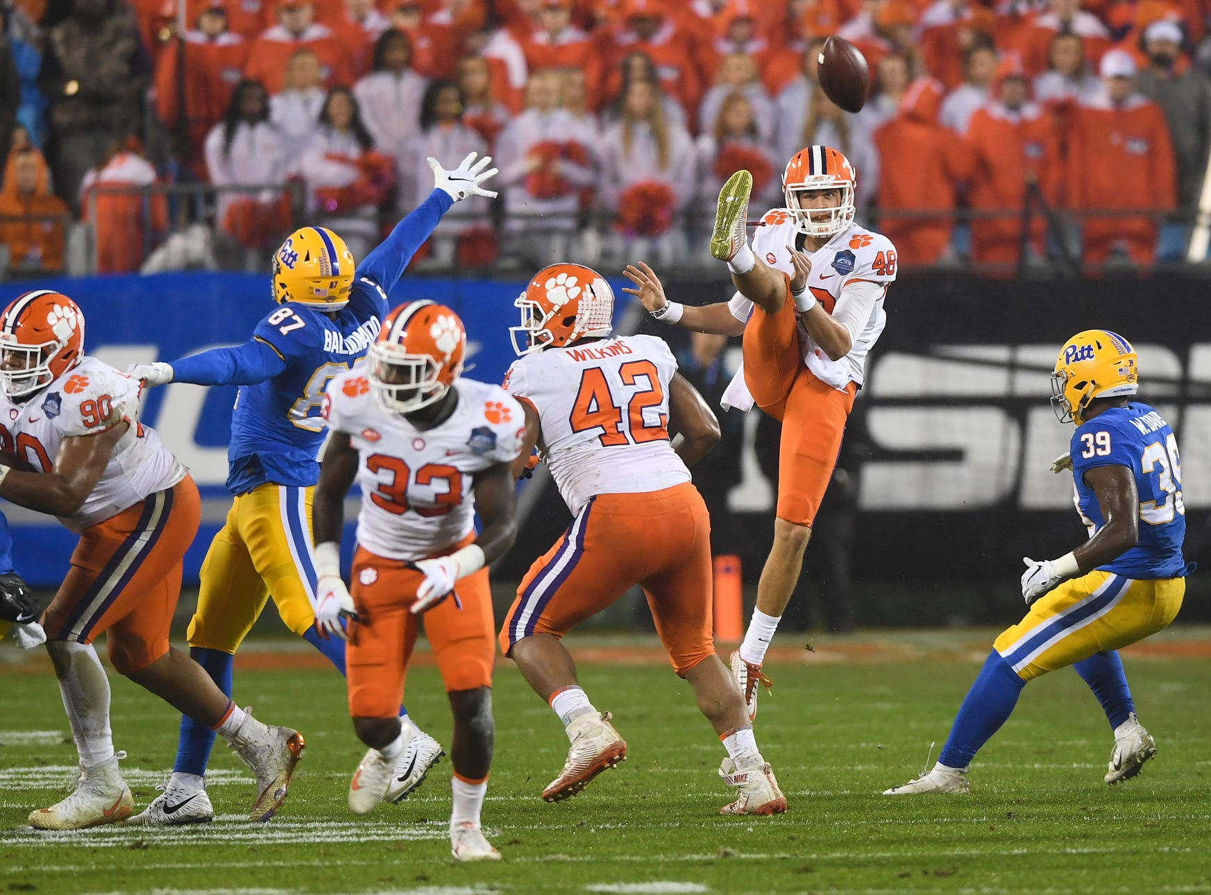 Clemson punter Will Spiers (48) punts against Pittsburgh during the 1st quarter of the Dr. Pepper ACC Championship at Bank of America Stadium in Charlotte, N.C. Saturday, December 1, 2018.