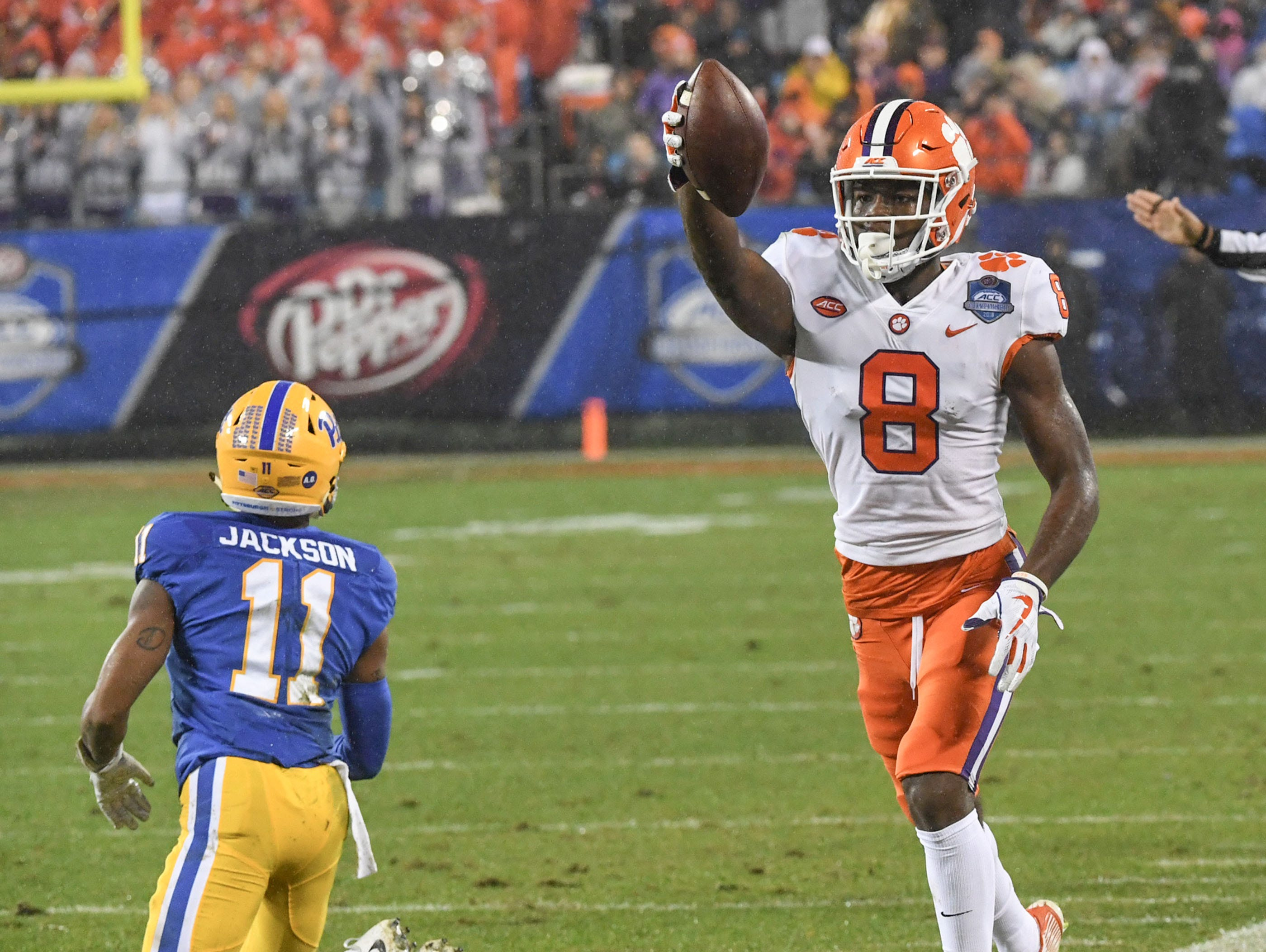 Clemson wide receiver Justyn Ross (8) gets a first down near Pittsburgh receiver Taysir Mack(11) during the first quarter of the Dr. Pepper ACC football championship at Bank of America Stadium in Charlotte, N.C. on Saturday, December 1, 2018.