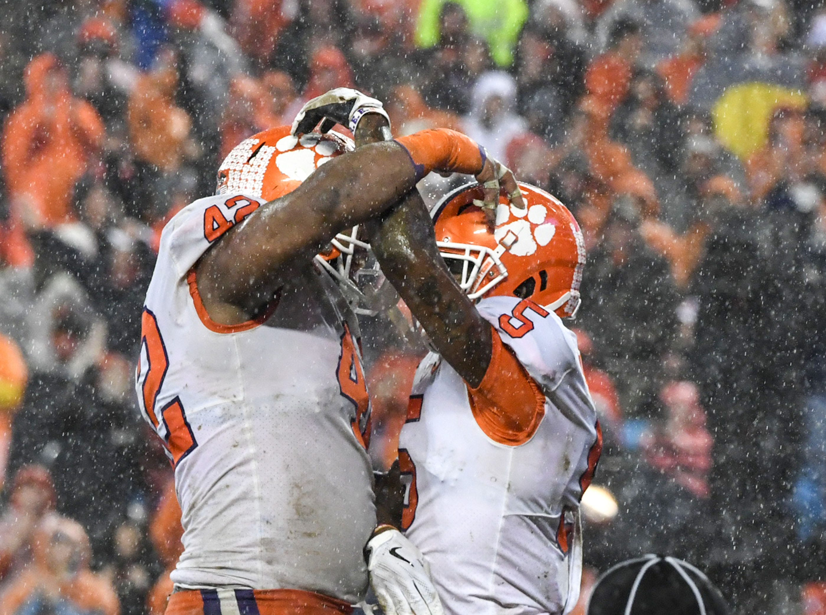 Clemson defensive lineman Christian Wilkins (42) celebrates the touchdown by wide receiver Tee Higgins (5) against Pittsburgh during the second quarter of the Dr. Pepper ACC football championship at Bank of America Stadium in Charlotte, N.C. on Saturday, December 1, 2018.