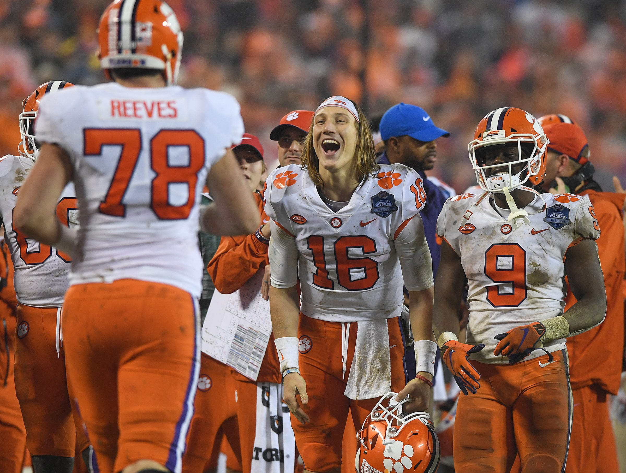 Clemson quarterback Trevor Lawrence (16) celebrates as the 2nd string offense comes off the field after scoring against Pittsburgh during the 4th quarter of the Dr. Pepper ACC Championship at Bank of America Stadium in Charlotte, N.C. Saturday, December 1, 2018.