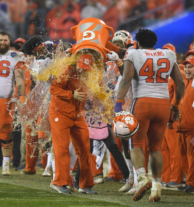 Clemson head coach Dabo Swinney is doused with Gator Ade during the closing seconds of the Tigers 42-10 win over Pittsburgh in the Dr. Pepper ACC Championship at Bank of America Stadium in Charlotte, N.C. Saturday, December 1, 2018.