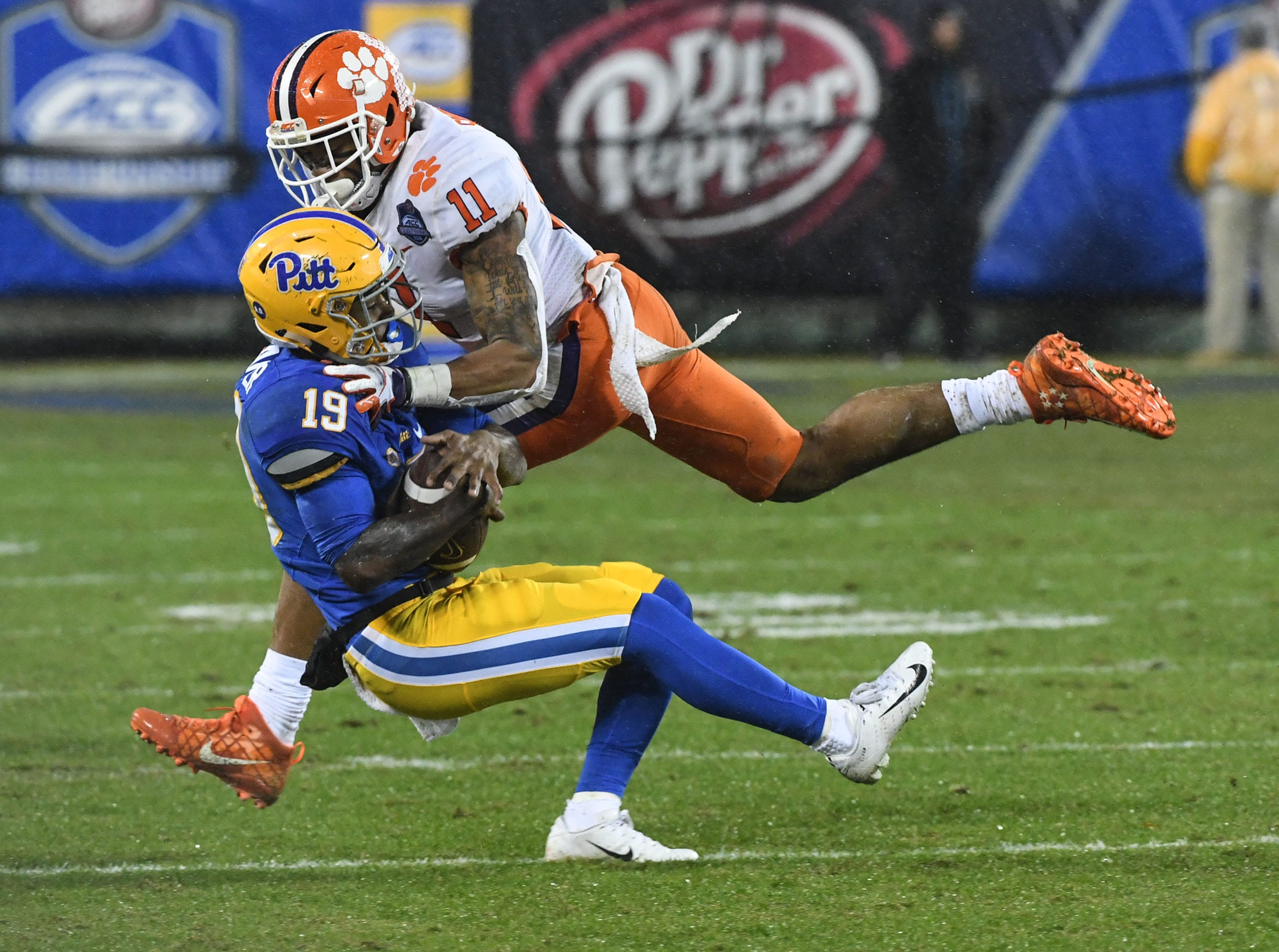Clemson safety Isaiah Simmons (11) tackles Pittsburgh receiver V'Lique Carter during the second quarter of the Dr. Pepper ACC football championship at Bank of America Stadium in Charlotte, N.C. on Saturday, December 1, 2018.