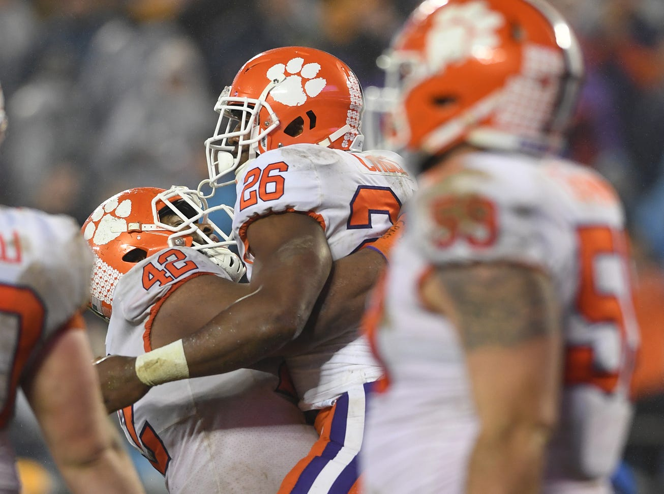 Clemson running back Adam Choice (26) celebrates with defensive lineman Christian Wilkins (42) after scoring against Pittsburgh during the 4th quarter of the Dr. Pepper ACC Championship at Bank of America Stadium in Charlotte, N.C. Saturday, December 1, 2018.