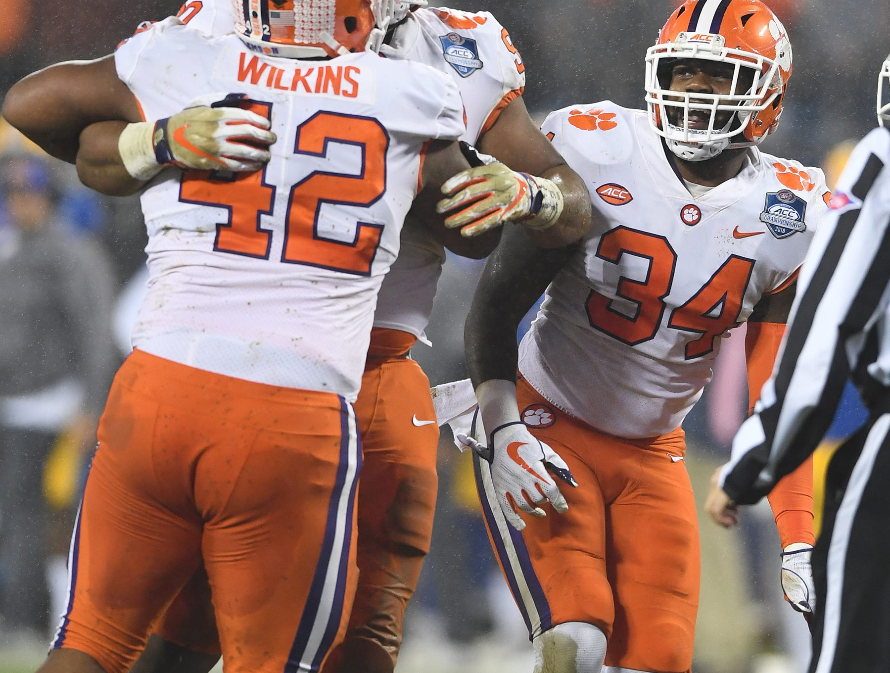 Clemson defensive lineman Christian Wilkins (42) celebrates with defensive lineman Dexter Lawrence (90) after a defensive stop against Pittsburgh during the 1st quarter of the Dr. Pepper ACC Championship at Bank of America Stadium in Charlotte, N.C. Saturday, December 1, 2018.