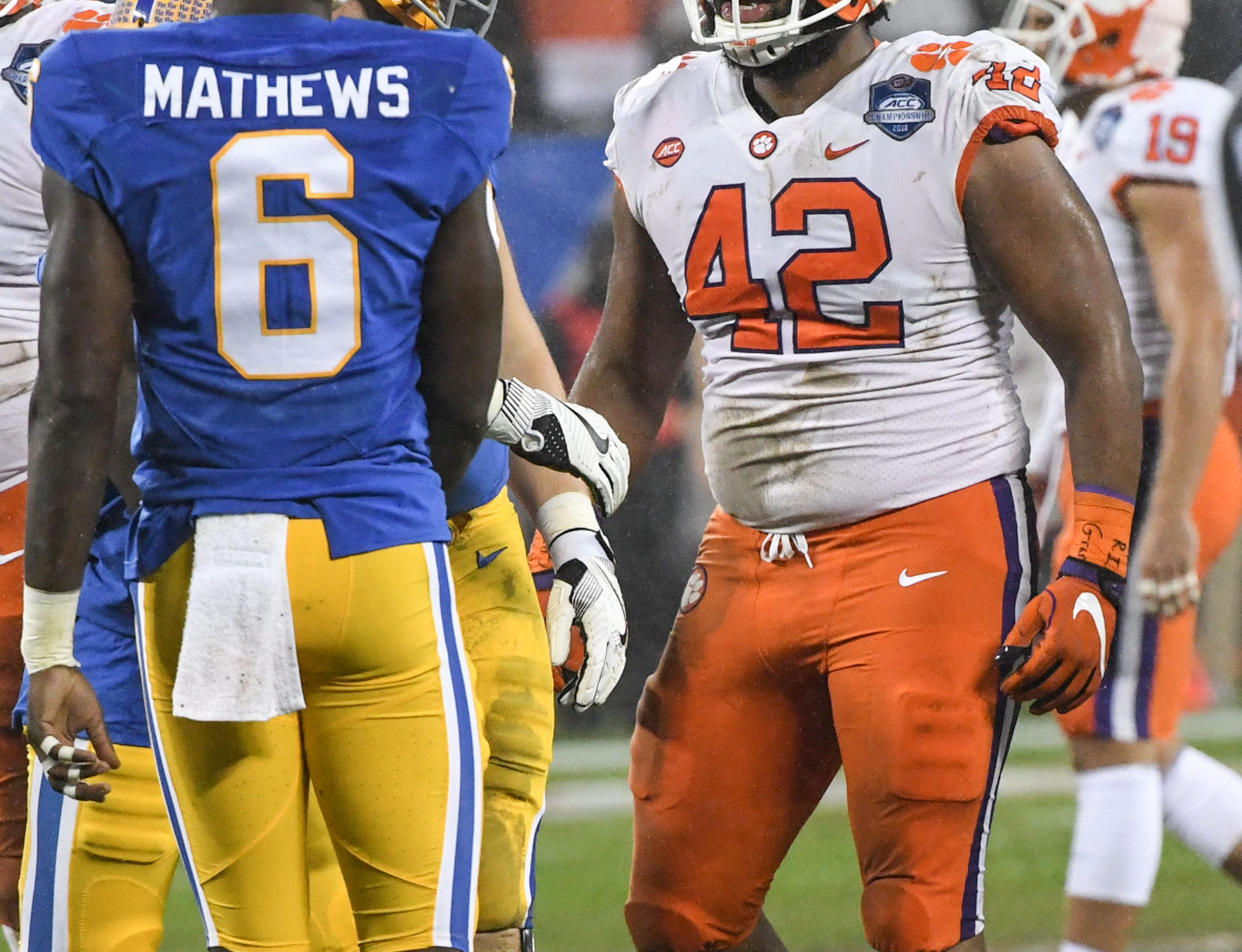 Clemson defensive lineman Christian Wilkins (42) talks to Pittsburgh players between plays during the first quarter of the Dr. Pepper ACC football championship at Bank of America Stadium in Charlotte, N.C. on Saturday, December 1, 2018.